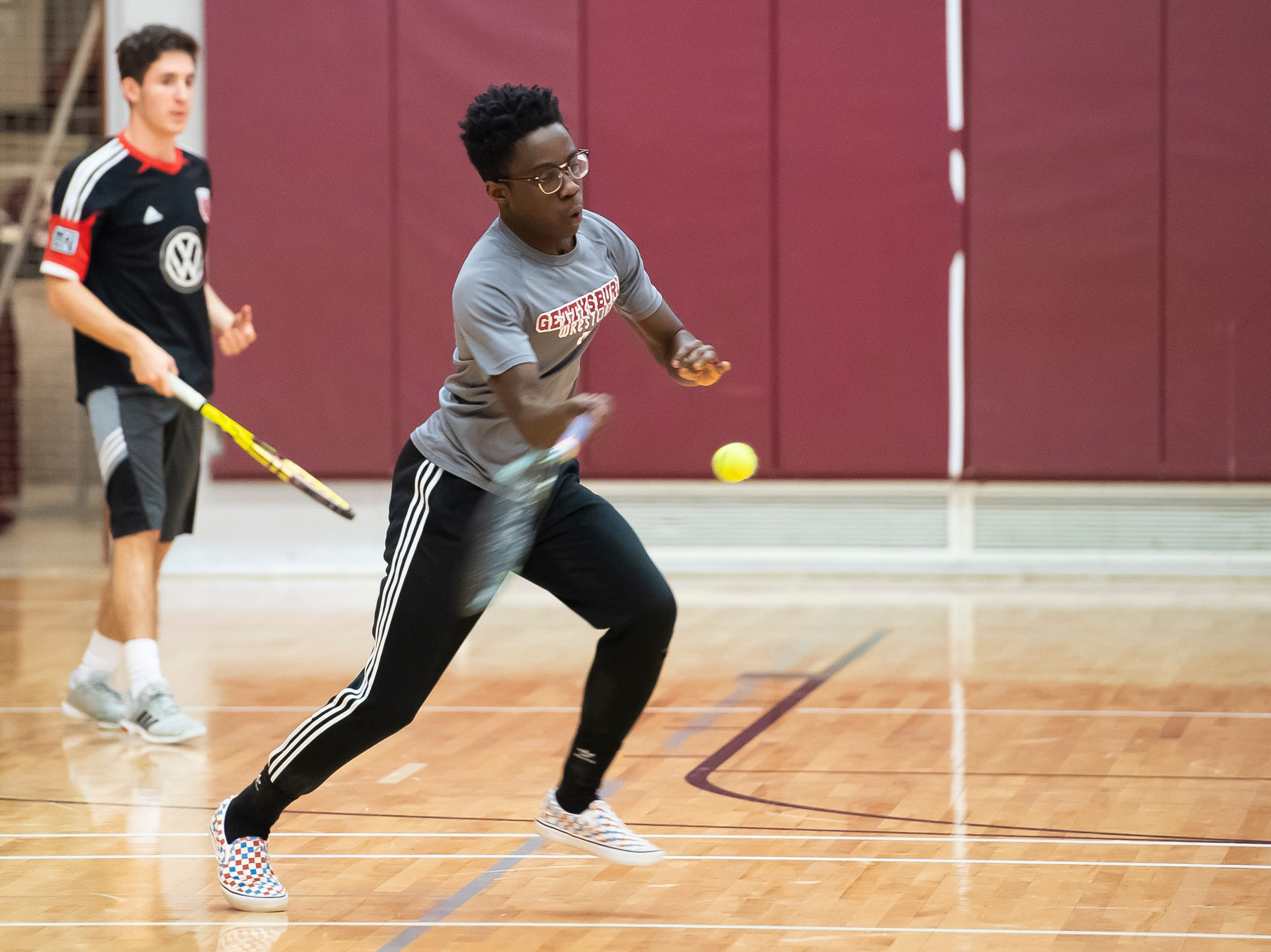 Kwaku Baryeh hits a forehand shot during a Gettysburg boys tennis drill on the first day of spring sports practice Monday, March 4, 2019.
