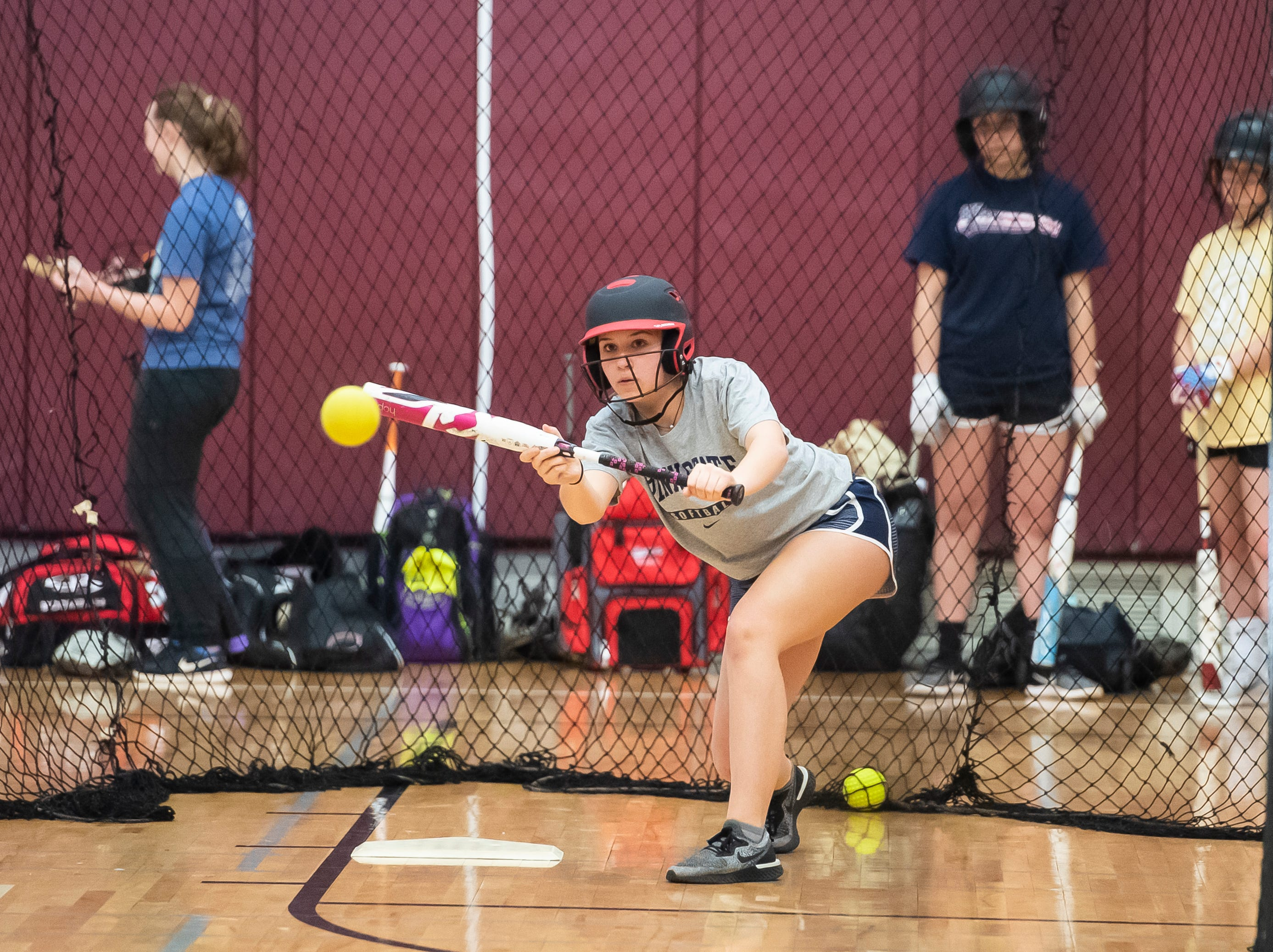 Gettysburg's Kaelyn Blocher practices bunting on the first day of softball practice Monday, March 4, 2019.