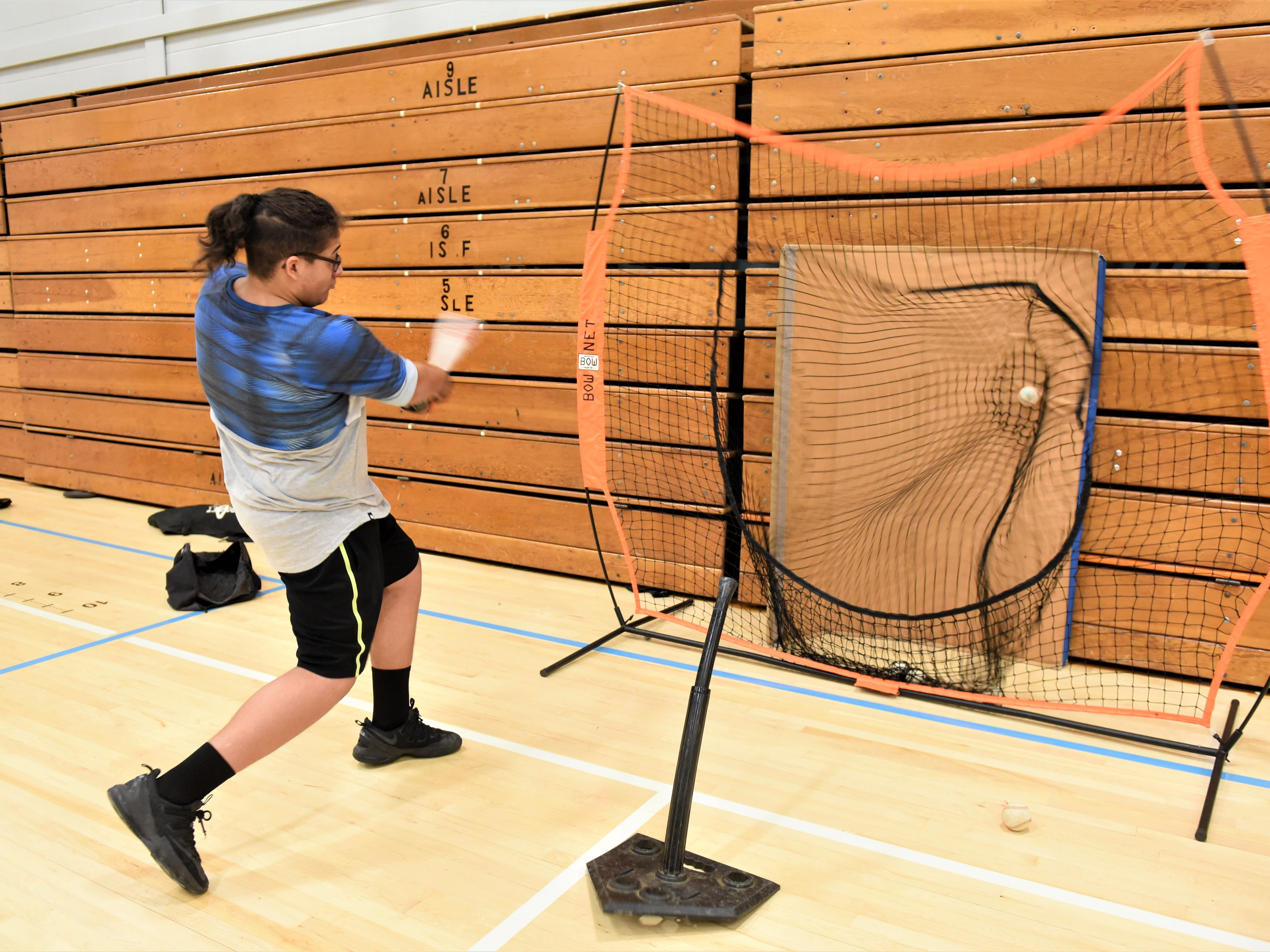 Hanover Senior High School baseball team practices indoors on first day of spring sports on March 4, 2019.