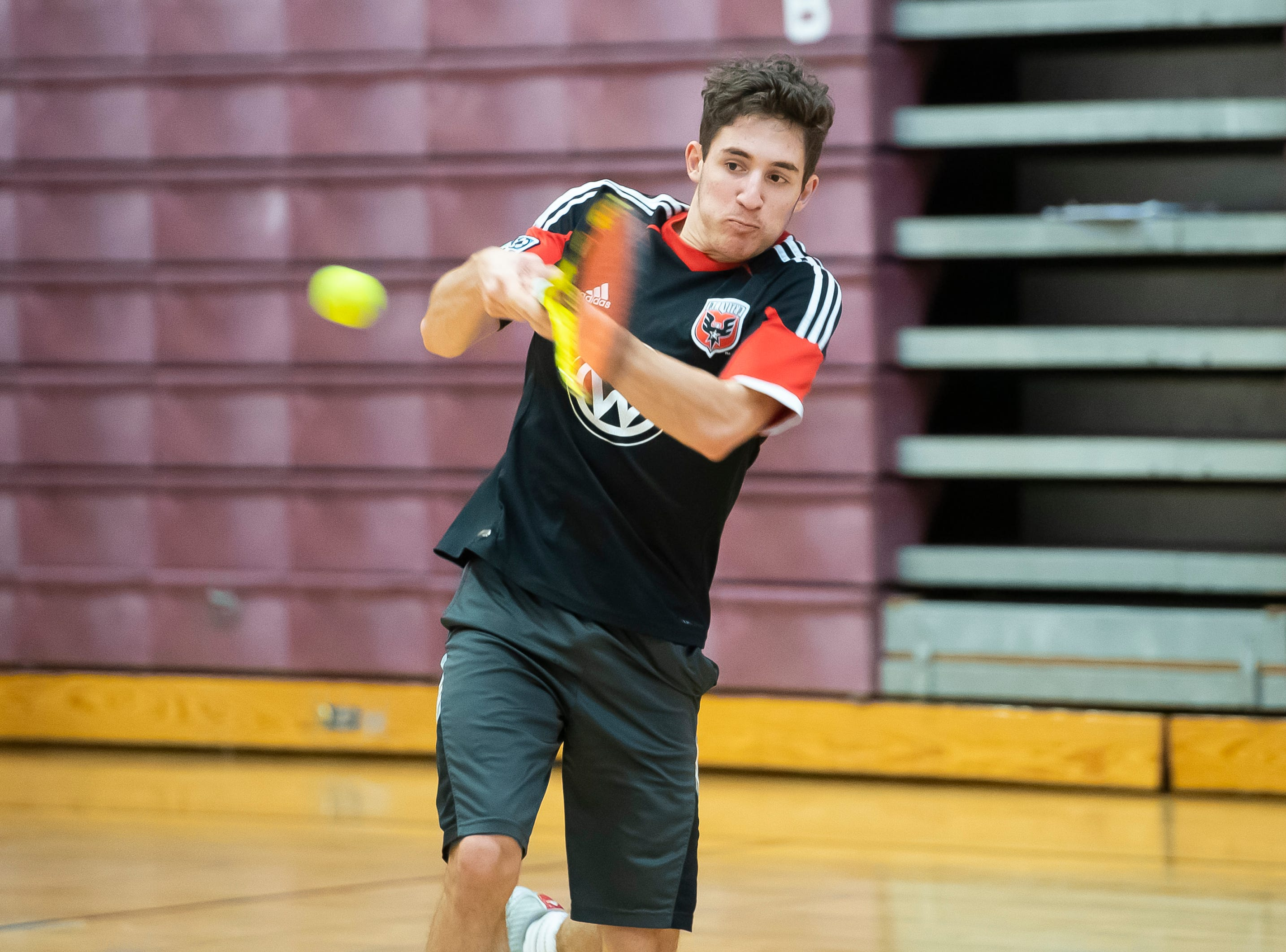 Gettysburg's Drew Heinzelmann hits the ball during a tennis drill on the first day of spring sports practice Monday, March 4, 2019.