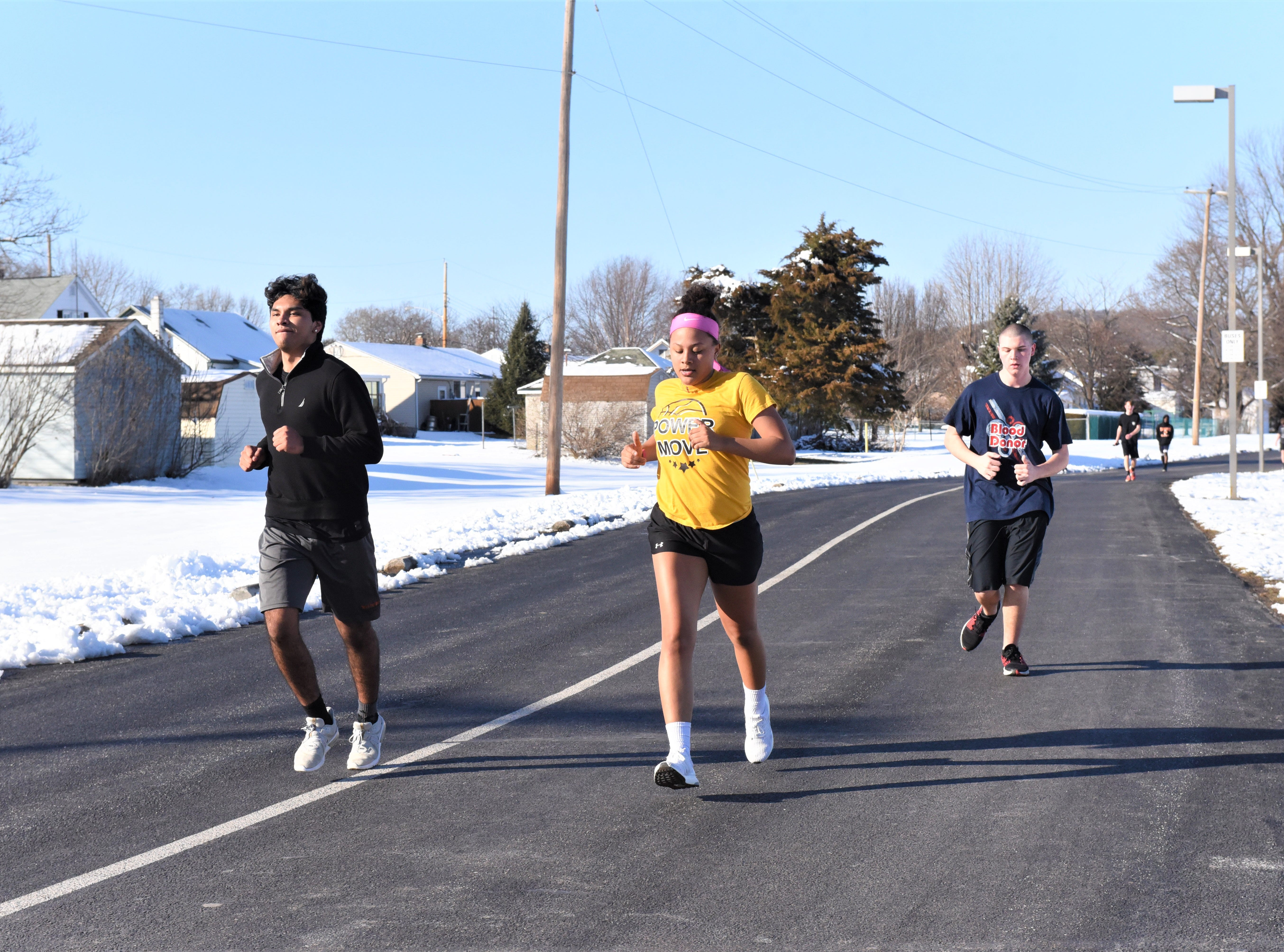 Despite the snow, Hanover Senior High School track and field team runs sprints on the first day of the spring sports season on March 4, 2019.