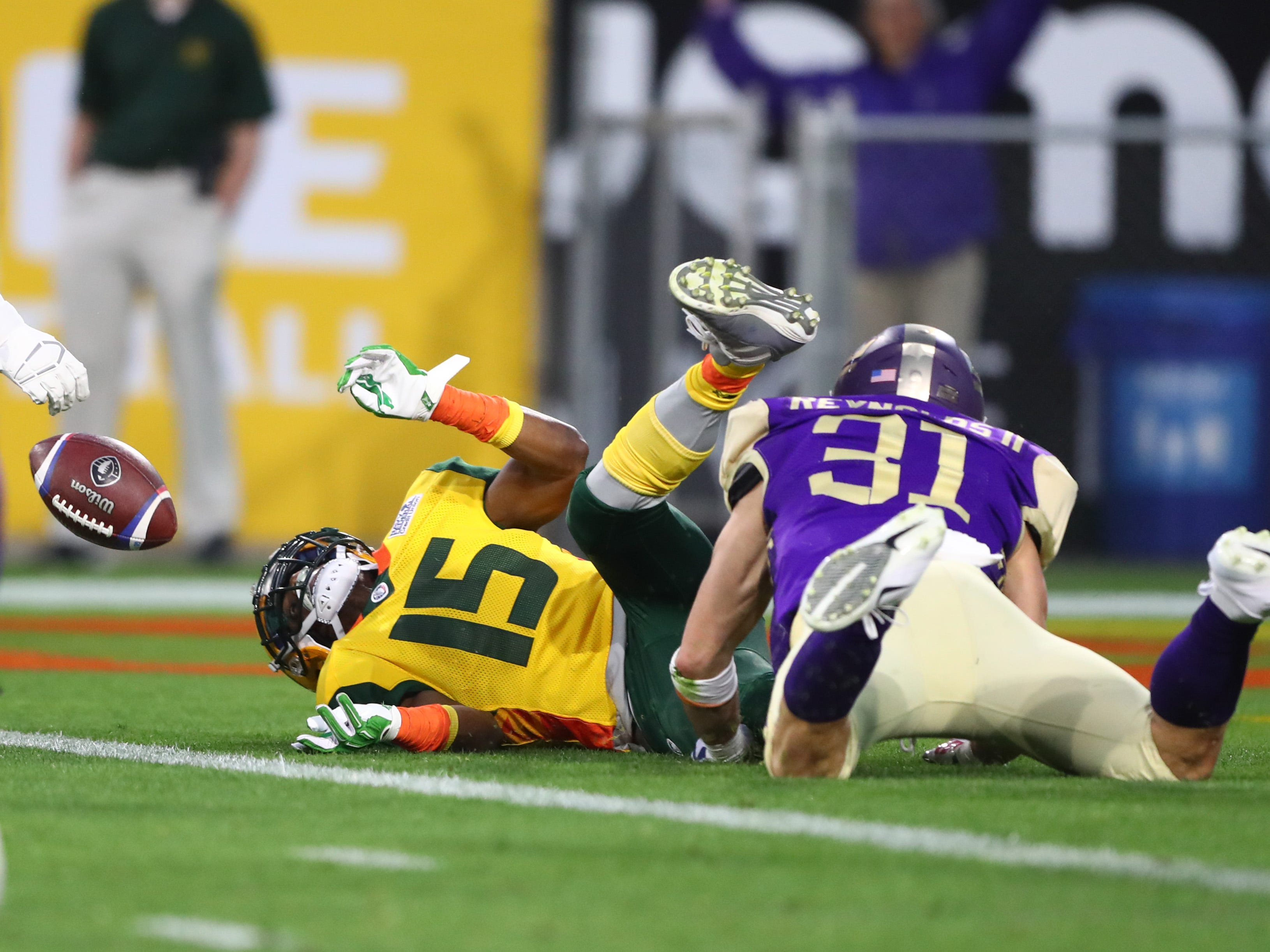 Mar 3, 2019; Tempe, AZ, USA; Arizona Hotshots wide receiver Rashad Ross (15) is tackled in the end zone by Atlanta Legends defensive back Ed Reynolds, Jr. (31) for a safety during the first half of an AAF football game at Sun Devil Stadium.
