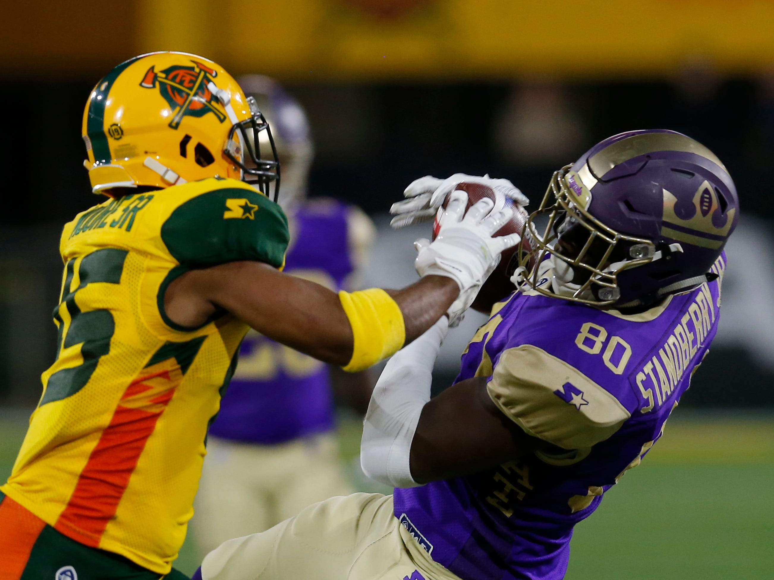 Atlanta Legends tight end Charles Standberry Jr. (80) catches the ball while being pressured by Arizona Hotshots defensive back Rahim Moore (45) in the second half during an AAF football game, Sunday, March 3, 2019, at Sun Devil Stadium in Phoenix.