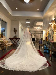 Gina Doloresco ordered this lacy, high-fashion wedding gown with a mermaid silhouette, a sweetheart neckline and a long train at Lillian Lottie Couture in Scottsdale. But the store closed suddenly, leaving her without a dress after paying more than $3,000.