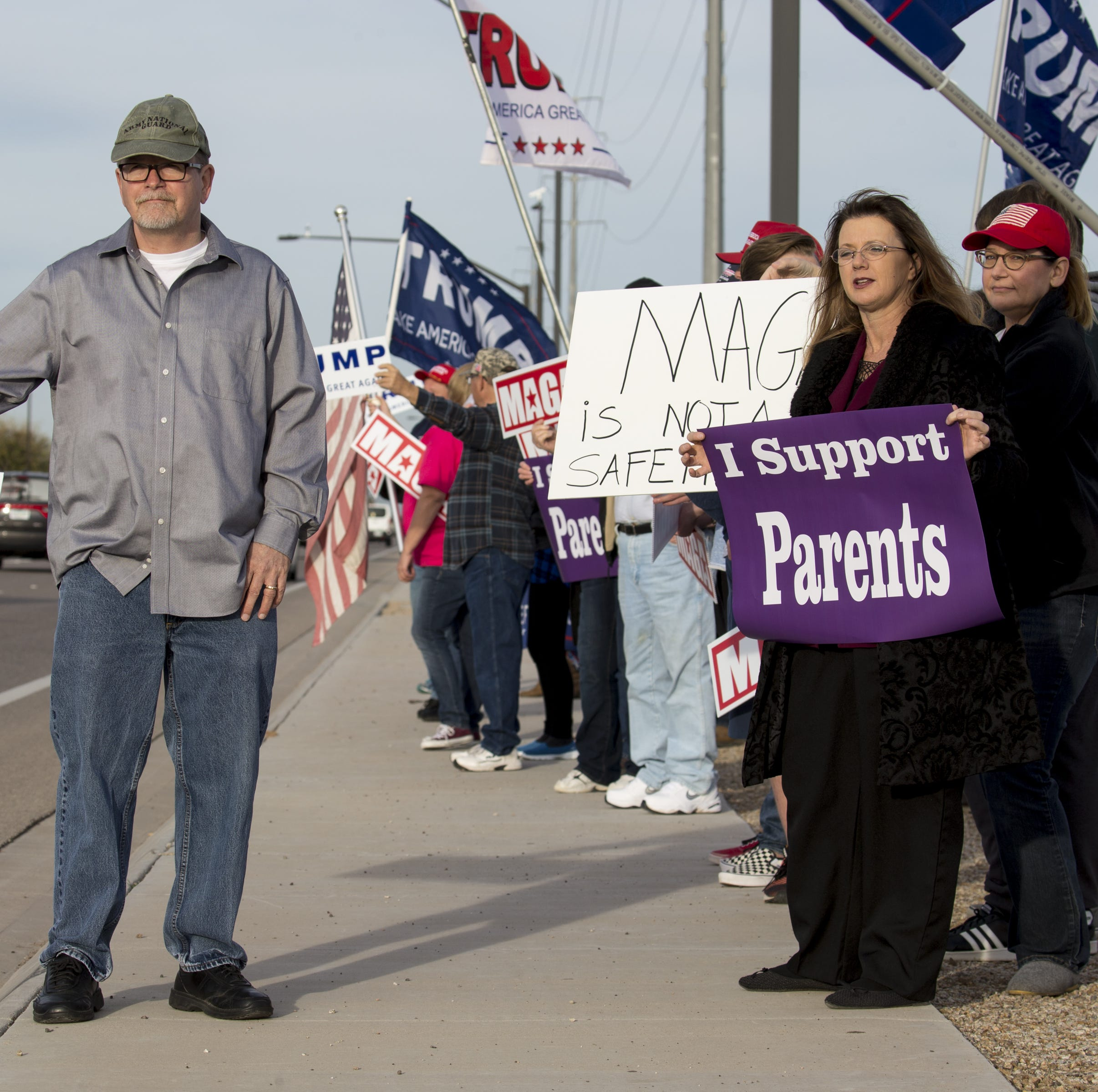 Protesters rally for First Amendment rights outside Perry High School in Gilbert