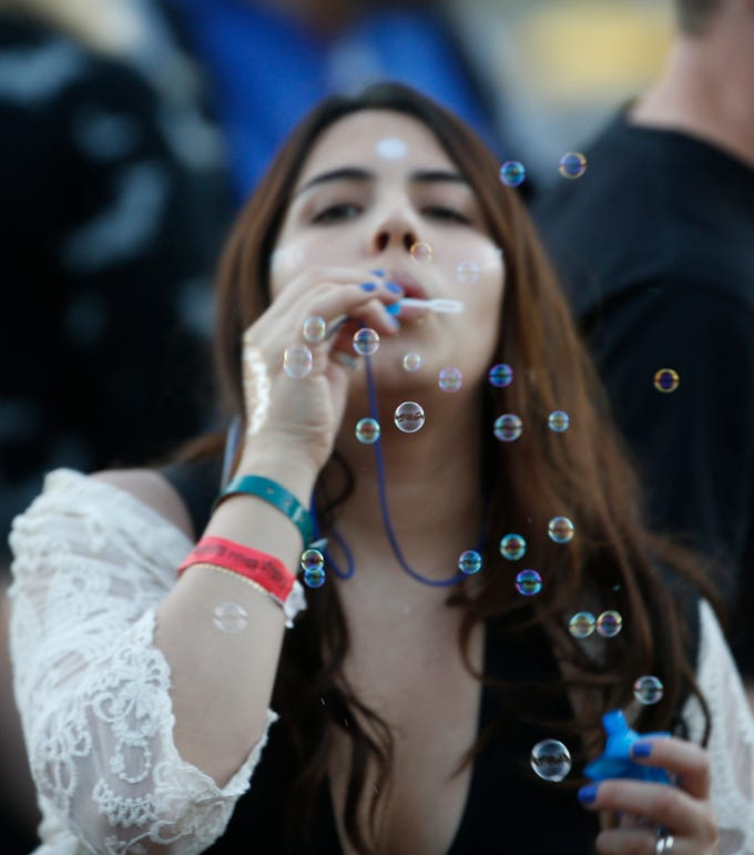 People blow bubbles as House of Treezus performs during McDowell Mountain Music Festival in Phoenix on March 3, 2019.
