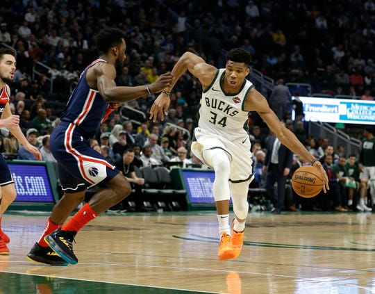 Milwaukee Bucks' Giannis Antetokounmpo drives against Washington Wizards' Jeff Green during the second half of an NBA basketball game Wednesday, Feb. 6, 2019, in Milwaukee. (AP Photo/Aaron Gash)
