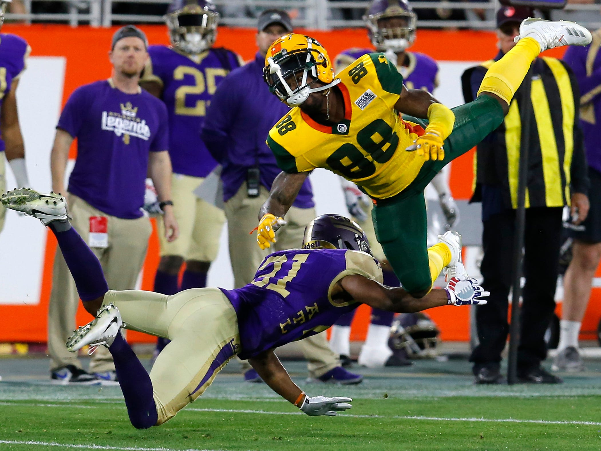 Atlanta Legends defensive back Doran Grant (21) breaks up a pass intended for Arizona Hotshots wide receiver Josh Huff (88) in the second half during an AAF football game, Sunday, March 3, 2019, at Sun Devil Stadium in Phoenix.