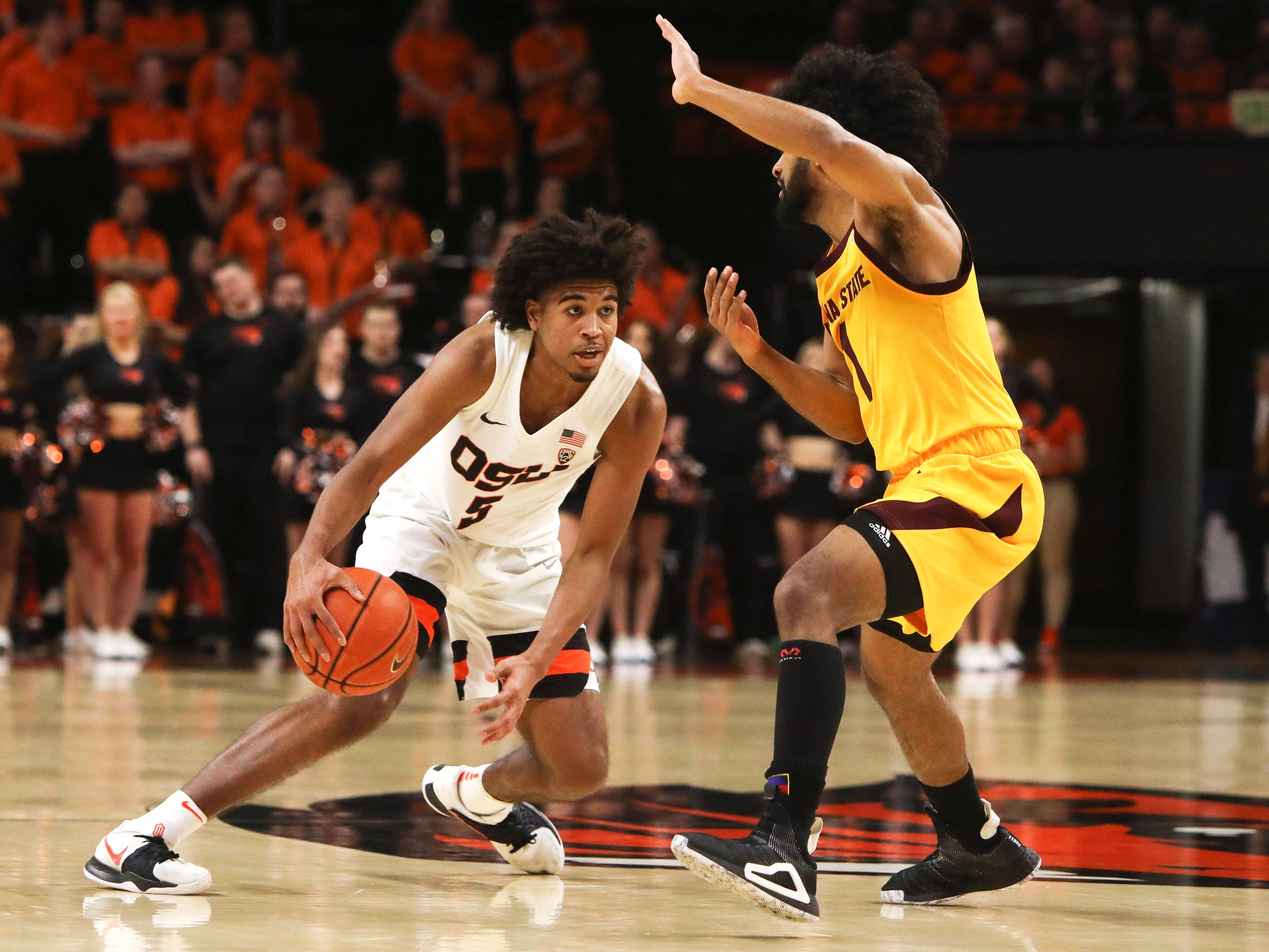 Oregon State's Ethan Thompson (5) tries to slip past Arizona State's Remy Martin (1) during the second half of an NCAA college basketball game in Corvallis, Ore., Sunday, March 3, 2019. Arizona State won 74-71.