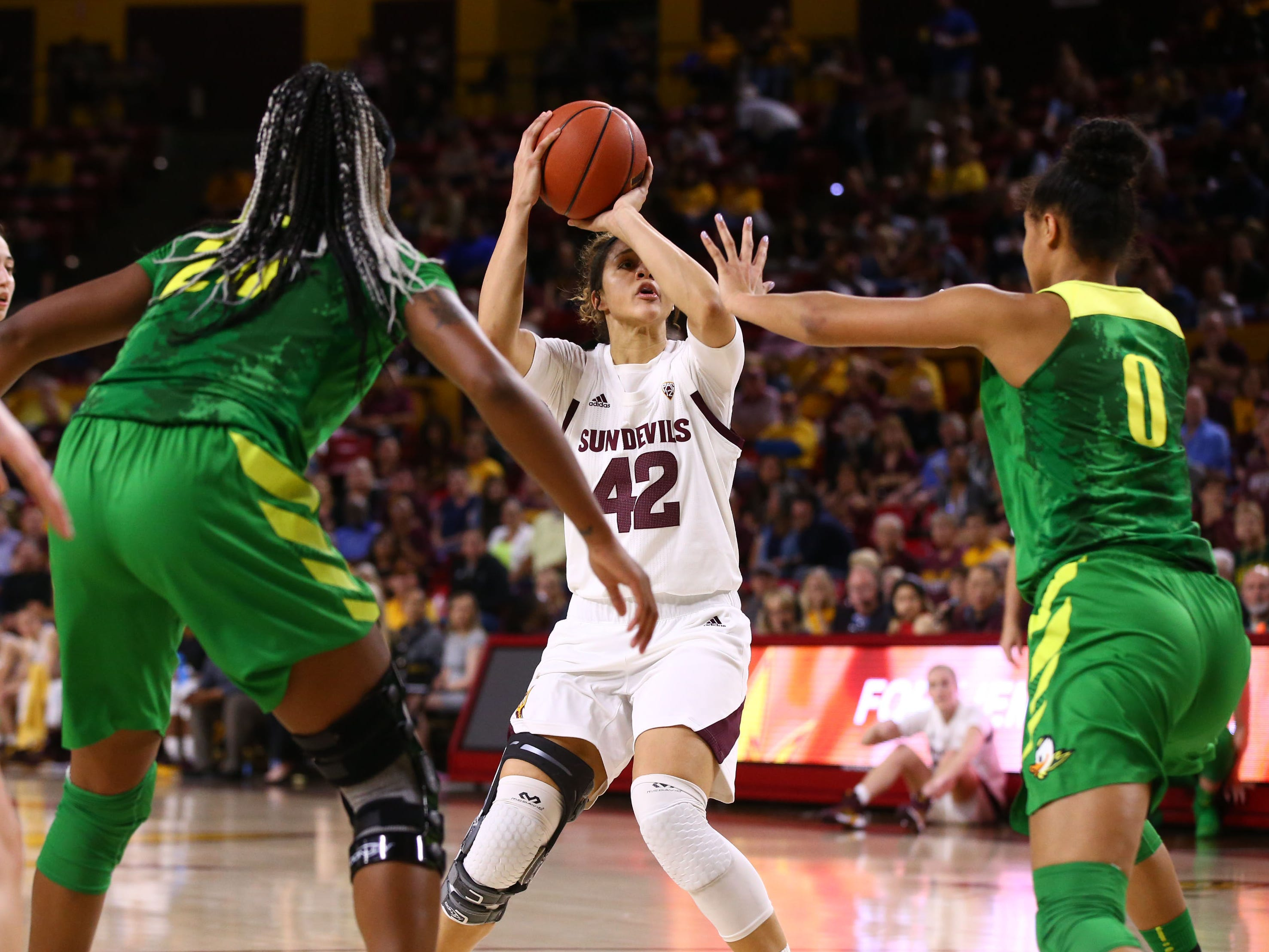 Arizona State Sun Devils forward Kianna Ibis (42) takes a shot against Oregon in the first half on Mar. 3, 2019, at Wells Fargo Arena in Tempe, Ariz.