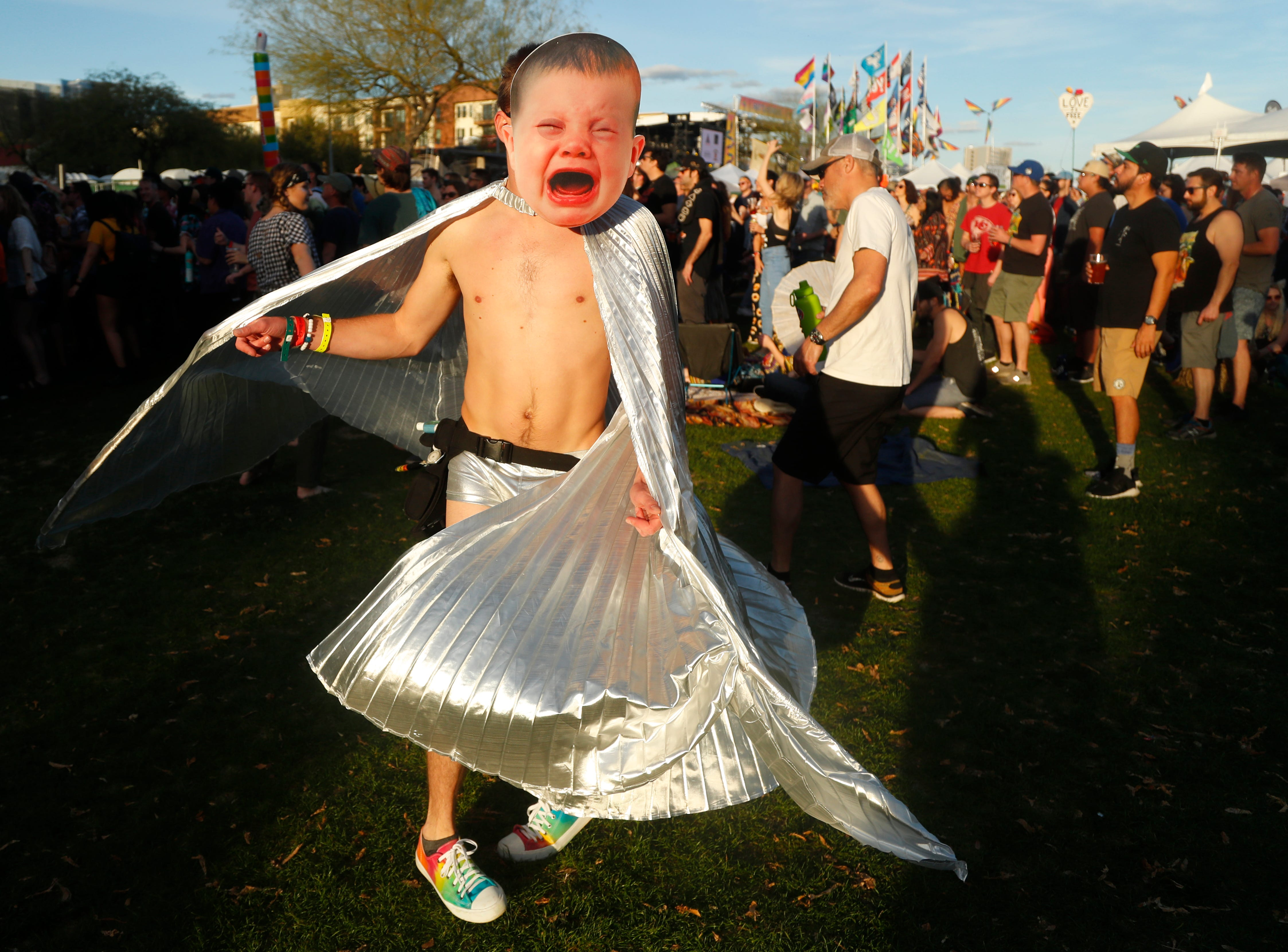 Jacob Shanahan dances with a baby mask on listening to Maribou State perform during McDowell Mountain Music Festival in Phoenix on March 3, 2019.