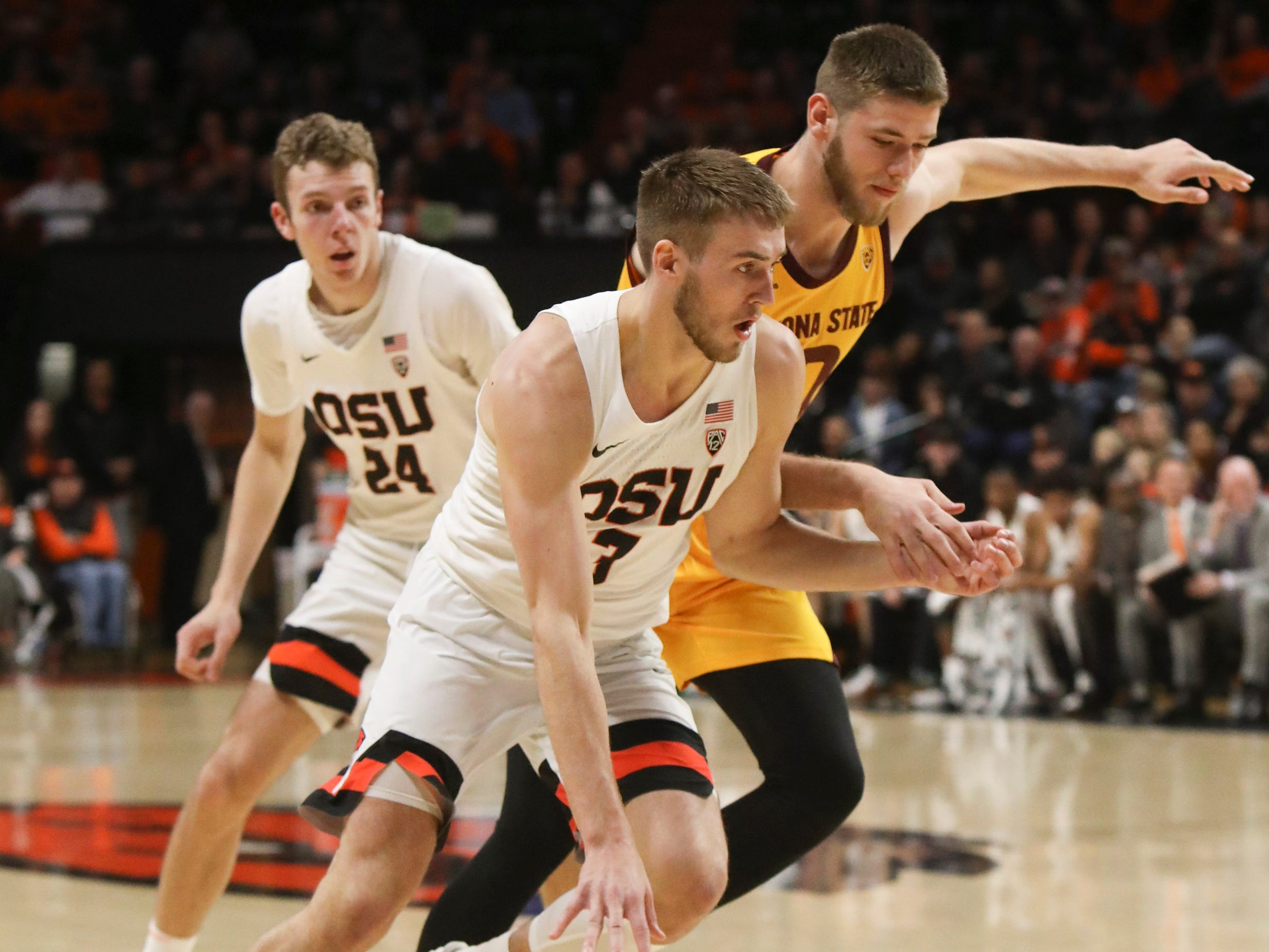 Oregon State's Tres Tinkle (3) tries to outrun Arizona State's Vitaliy Shibel (10) during the first half of an NCAA college basketball game in Corvallis, Ore., Sunday, March 3, 2019.