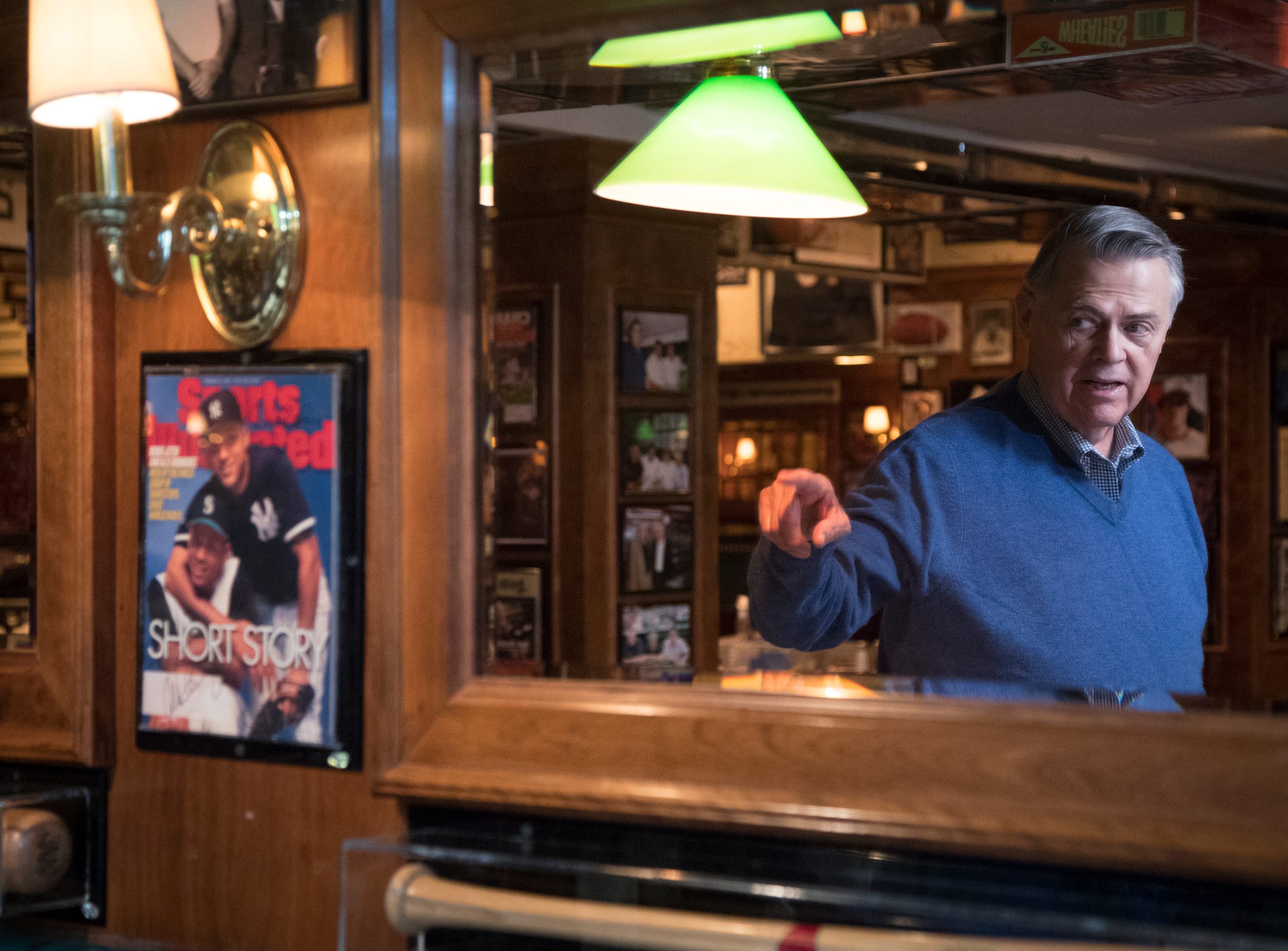 "Don Carson talks about the ""Sports Illustrated"" cover signed by Derek Jeter and Alex Rodriguez, on Feb. 27, 2019, at Don & Charlie's, 7501 E. Camelback Road, Scottsdale."