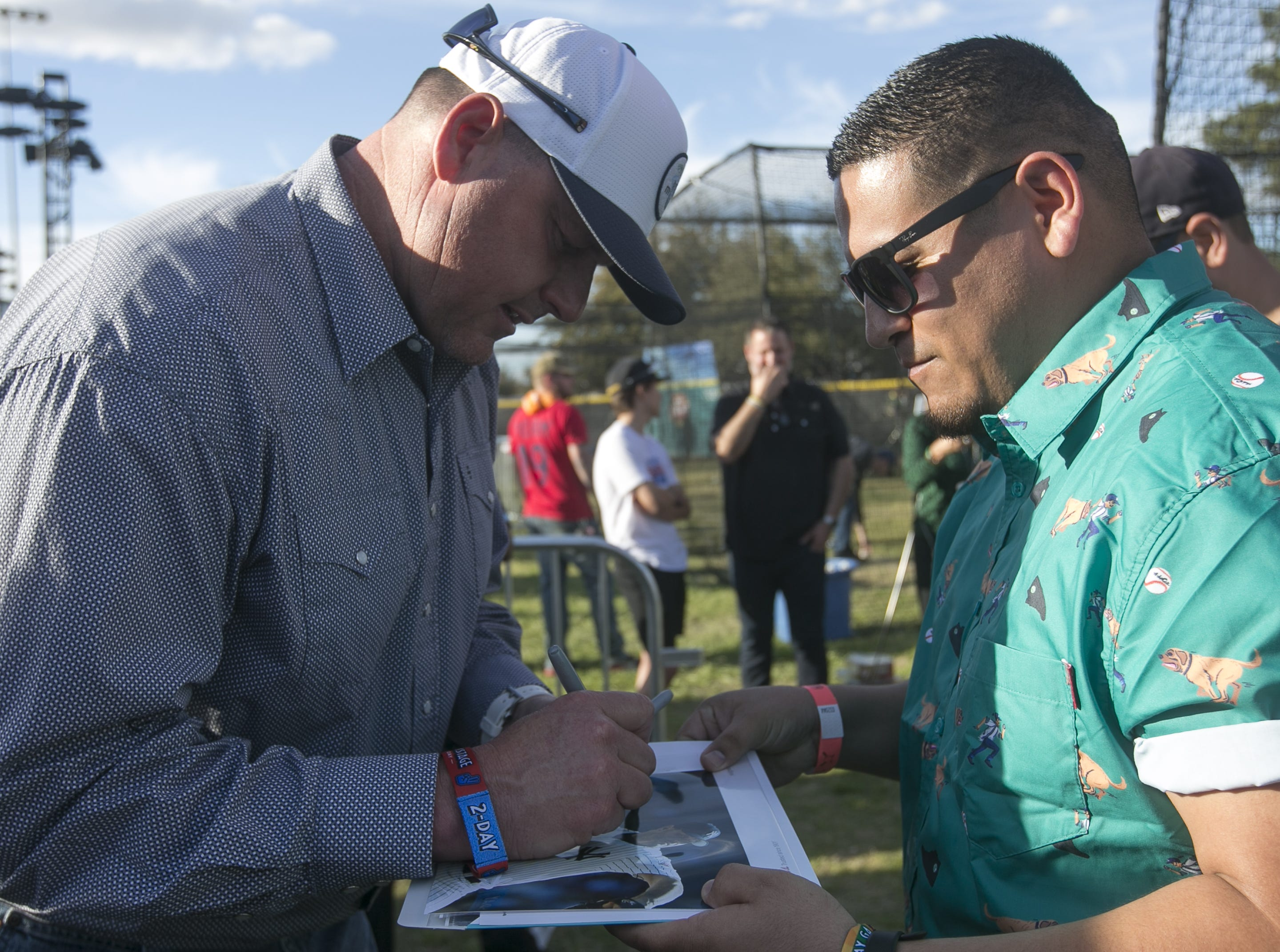 Former MLB pitcher Roger Clemens signs autographs at the Innings Festival at Tempe Beach Park on March 3, 2019.