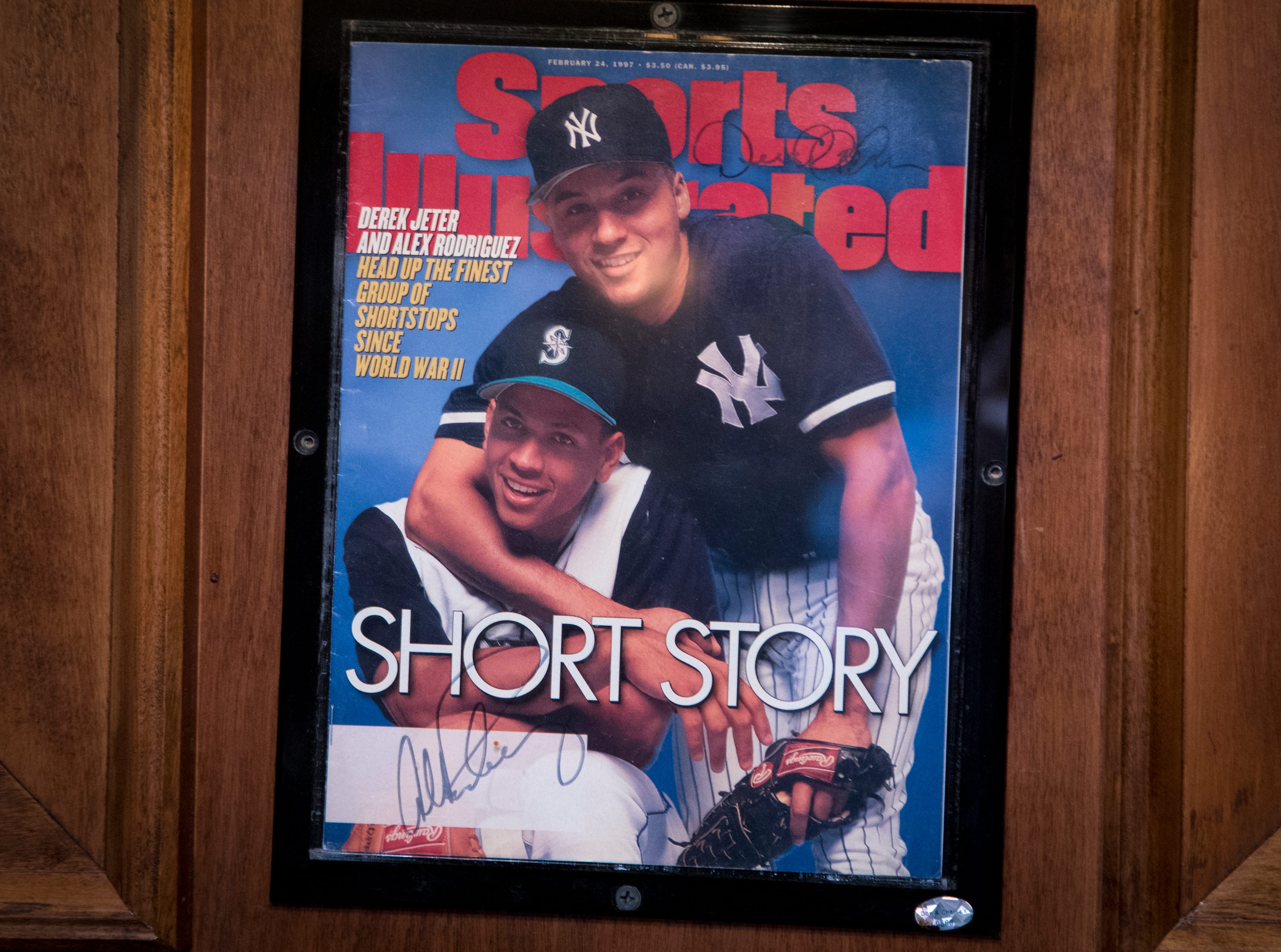 "The ""Sports Illustrated"" cover signed by Derek Jeter and Alex Rodriguez is seen Feb. 27, 2019, at Don & Charlie's, 7501 E. Camelback Road, Scottsdale."