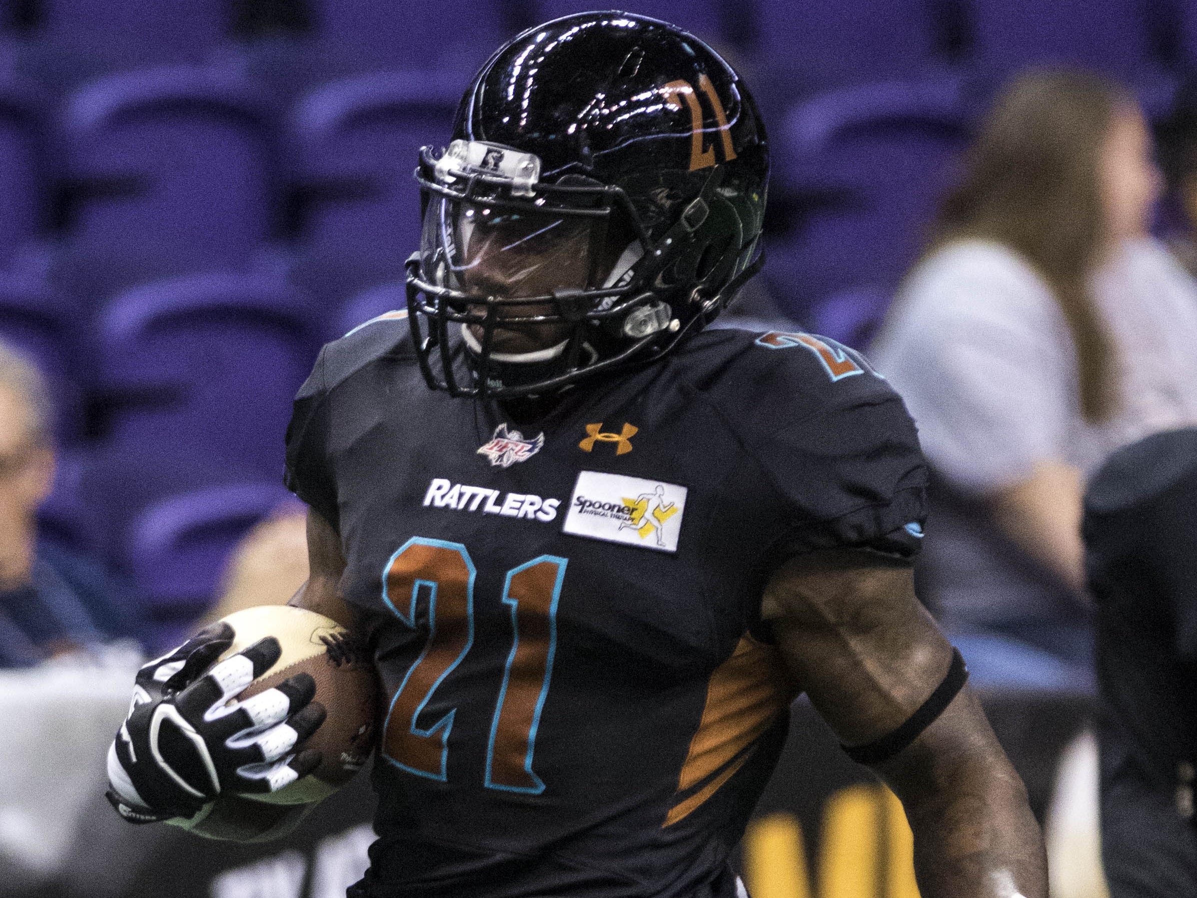 Arizona Rattlers' Jabre Lolley (21) carries the ball during warmups before their game with Cedar Rapids River Kings at Talking Stick Resort Arena in Phoenix, Sunday, March 3, 2019.