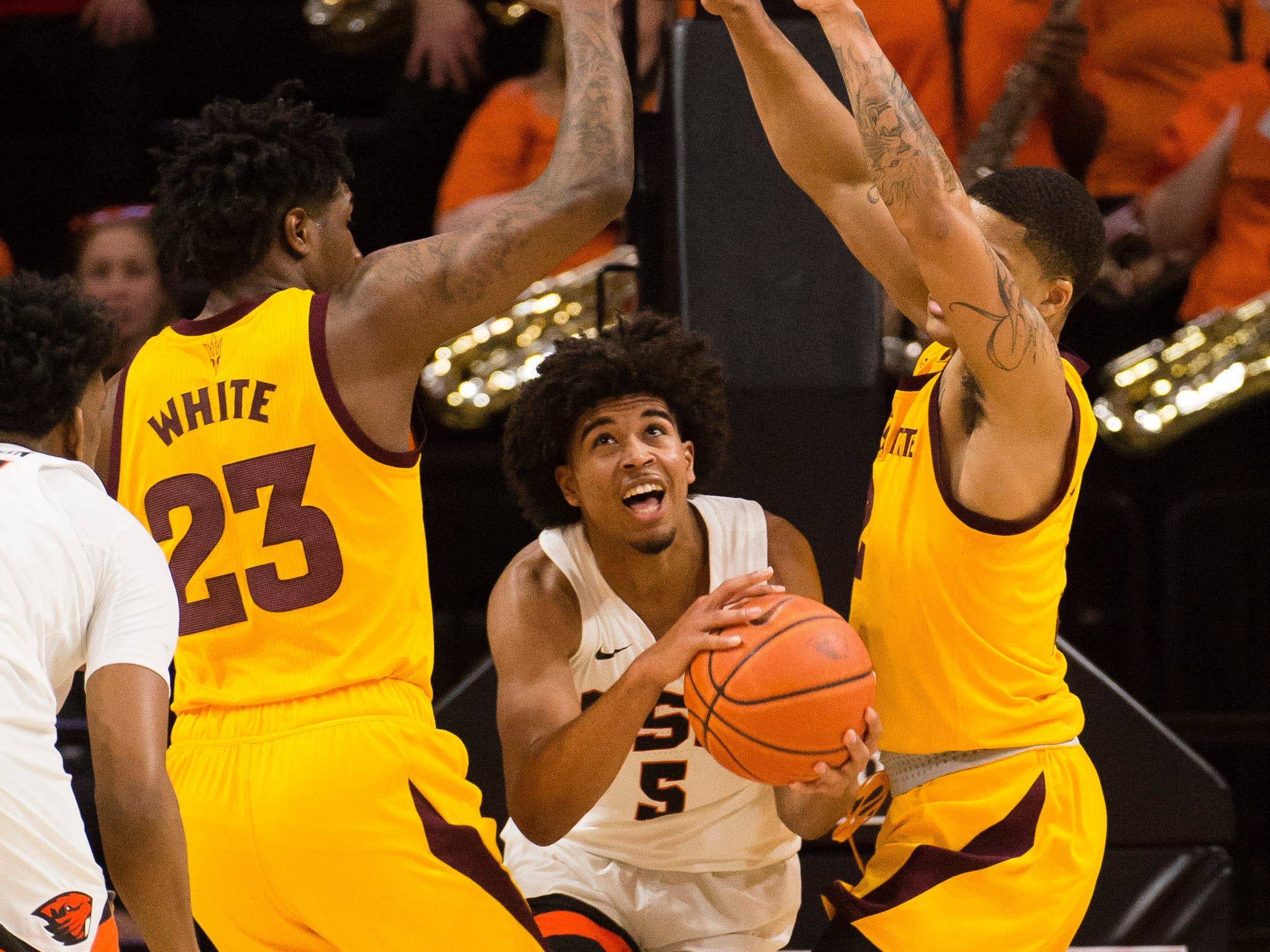 Mar 3, 2019; Corvallis, OR, USA; Oregon State Beavers guard Ethan Thompson (5) is defended by Arizona State Sun Devils forward Romello White (23) and guard Rob Edwards (2) during the first half at Gill Coliseum.