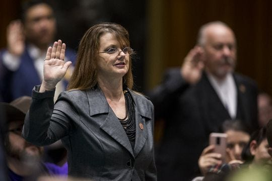 Rep. Kelly Townsend takes the oath of office with legislators during Opening Day of the Legislature on Jan. 14, 2019, at the Arizona House of Representatives Chambers in Phoenix.