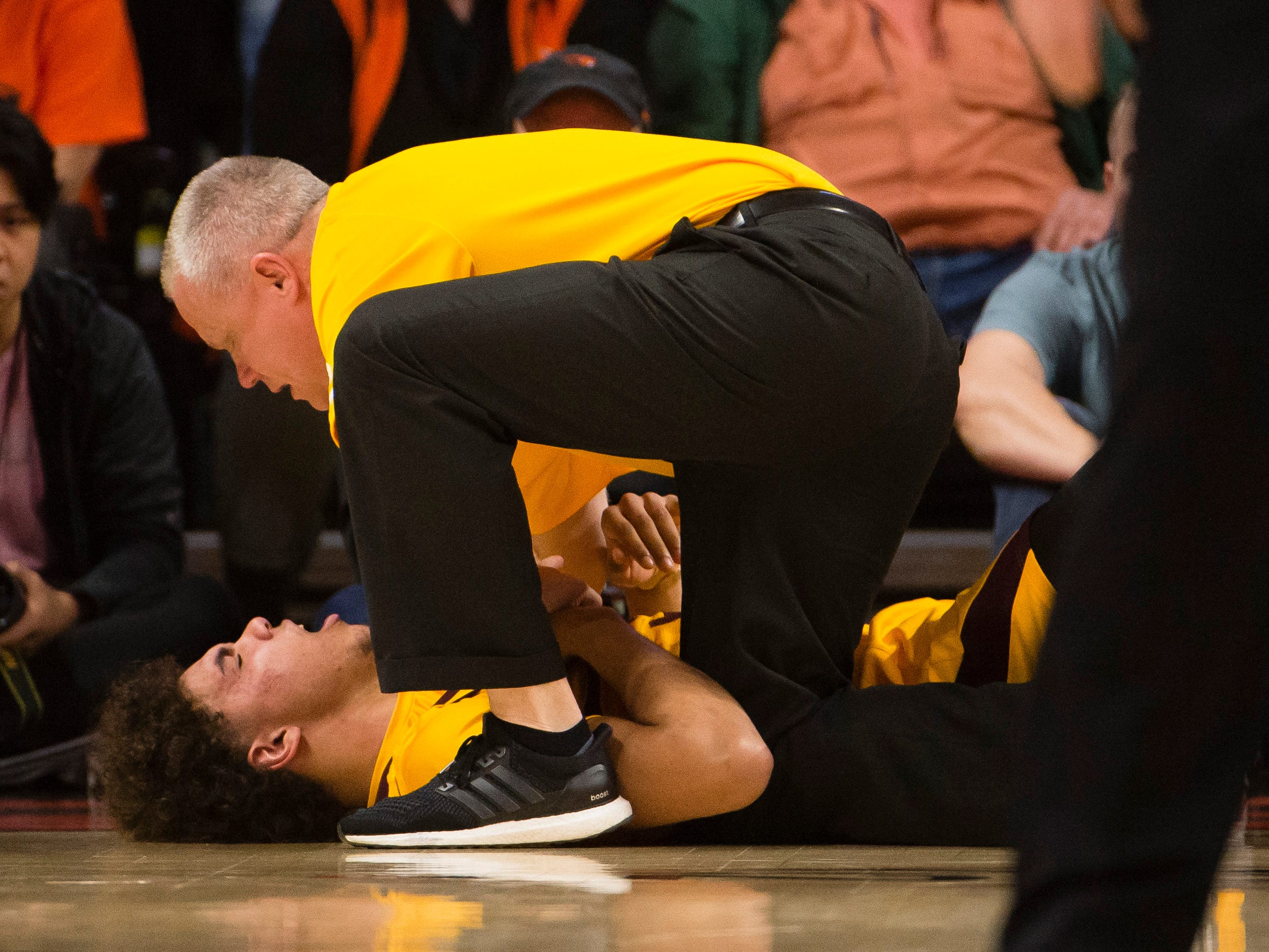 Mar 3, 2019; Corvallis, OR, USA; Arizona State Sun Devils forward Taeshon Cherry (35) is examined by a trainer after getting injured during the first half against the Oregon State Beavers at Gill Coliseum.