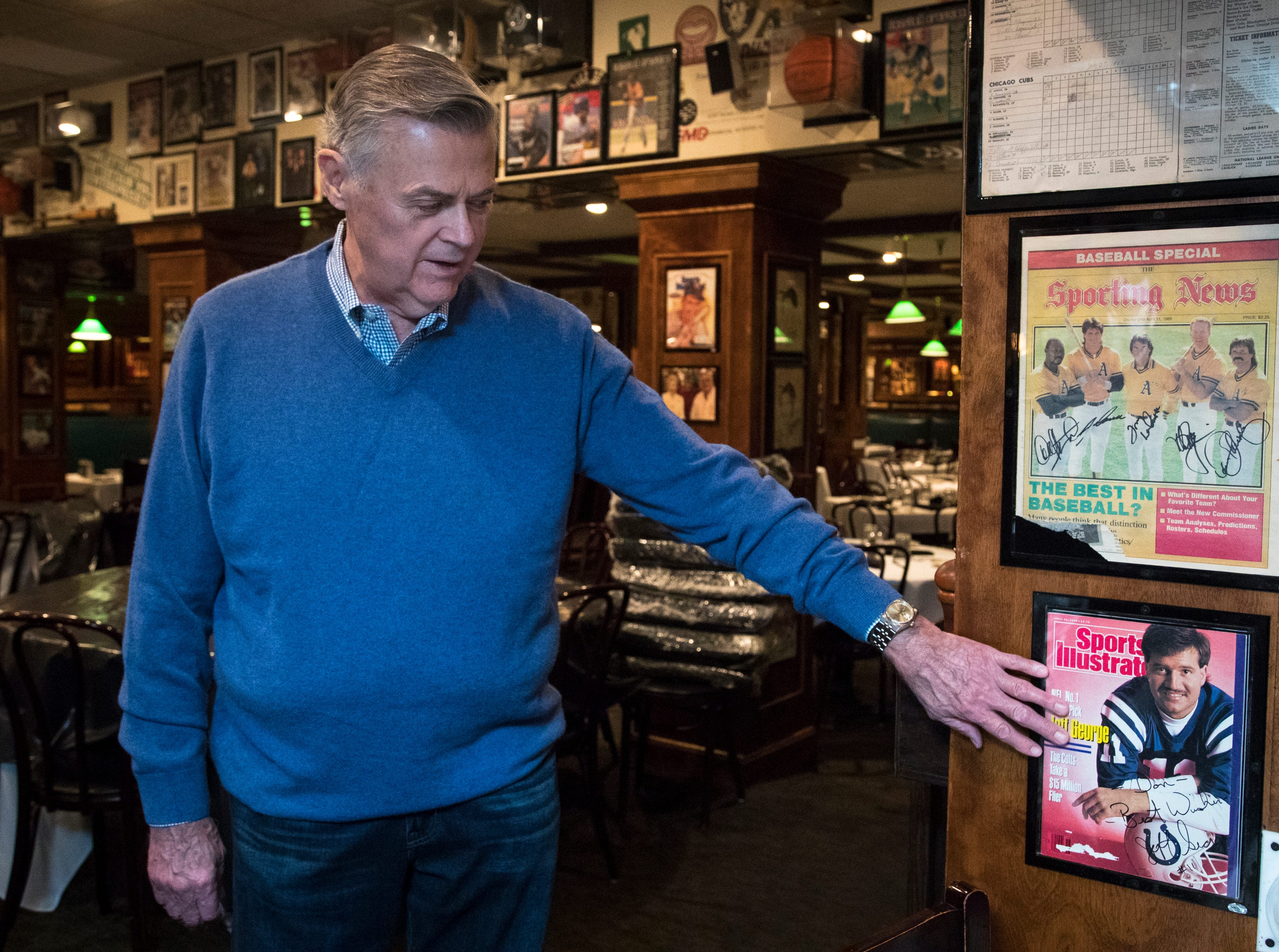 "Don Carson reminisces about the Jeff George ""Sports Illustrated"" cover Feb. 27, 2019, at Don & Charlie's, 7501 E. Camelback Road, Scottsdale."