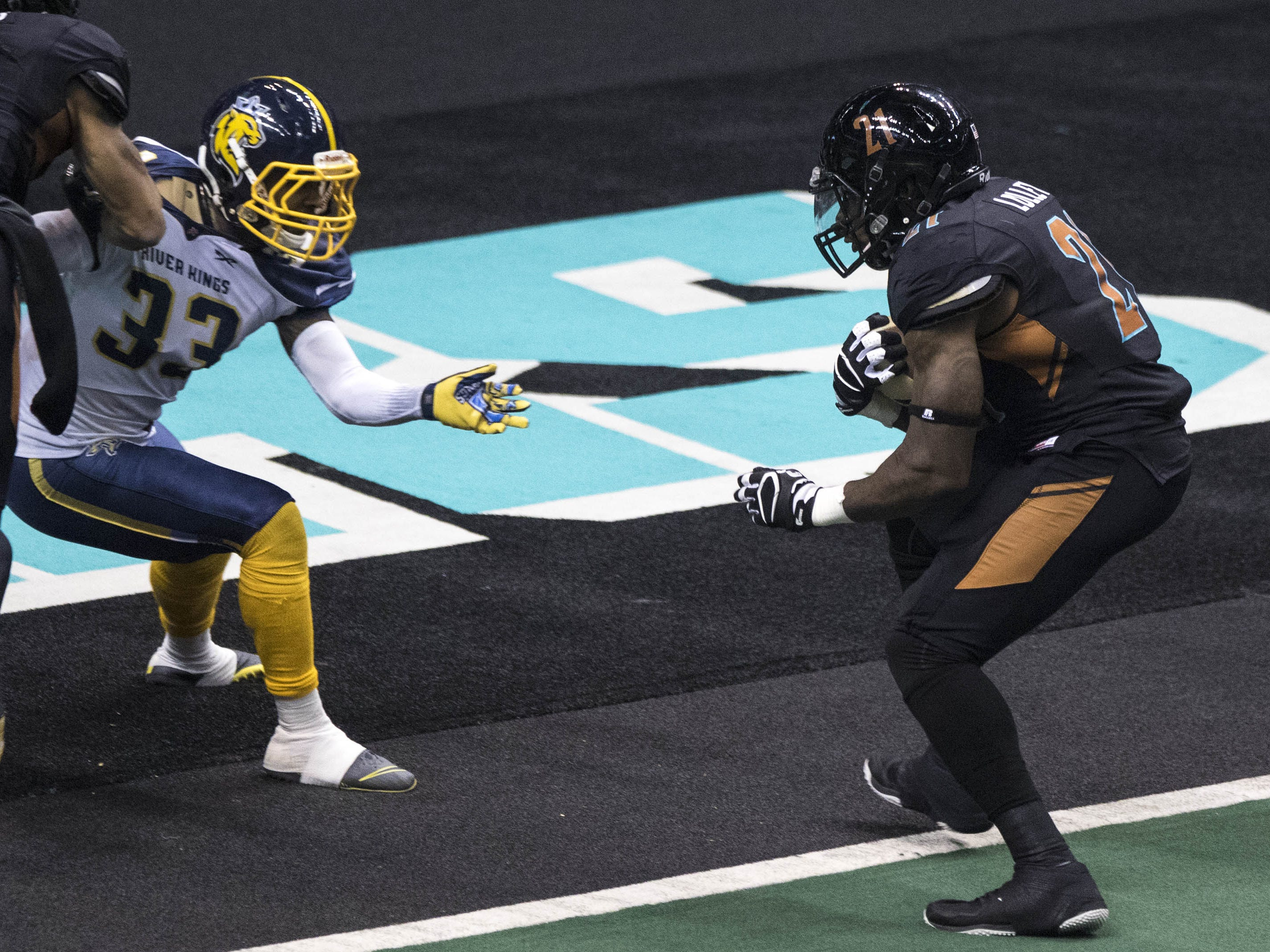 Arizona Rattlers' Jabre Lolley (21) crosses the goal line as Cedar Rapids River Kings' Tavion Garrison (33) gets blocked during the first half of their game at Talking Stick Resort Arena in Phoenix, Sunday, March 3, 2019.
