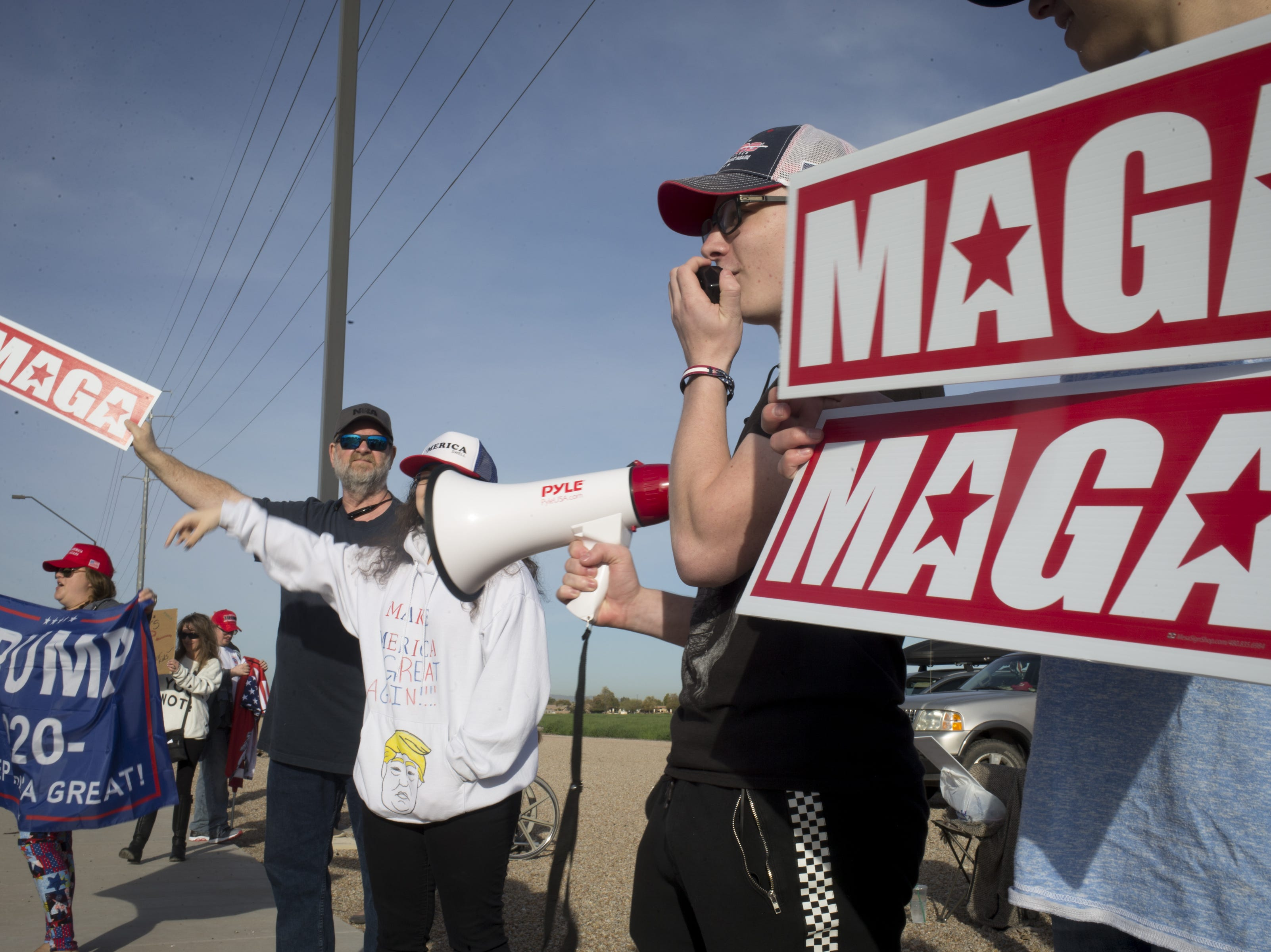 Sophomore Sam Wurst (second from right) and others protests on Queen Creek Road March 4, 2019, across from Perry High School in Gilbert.