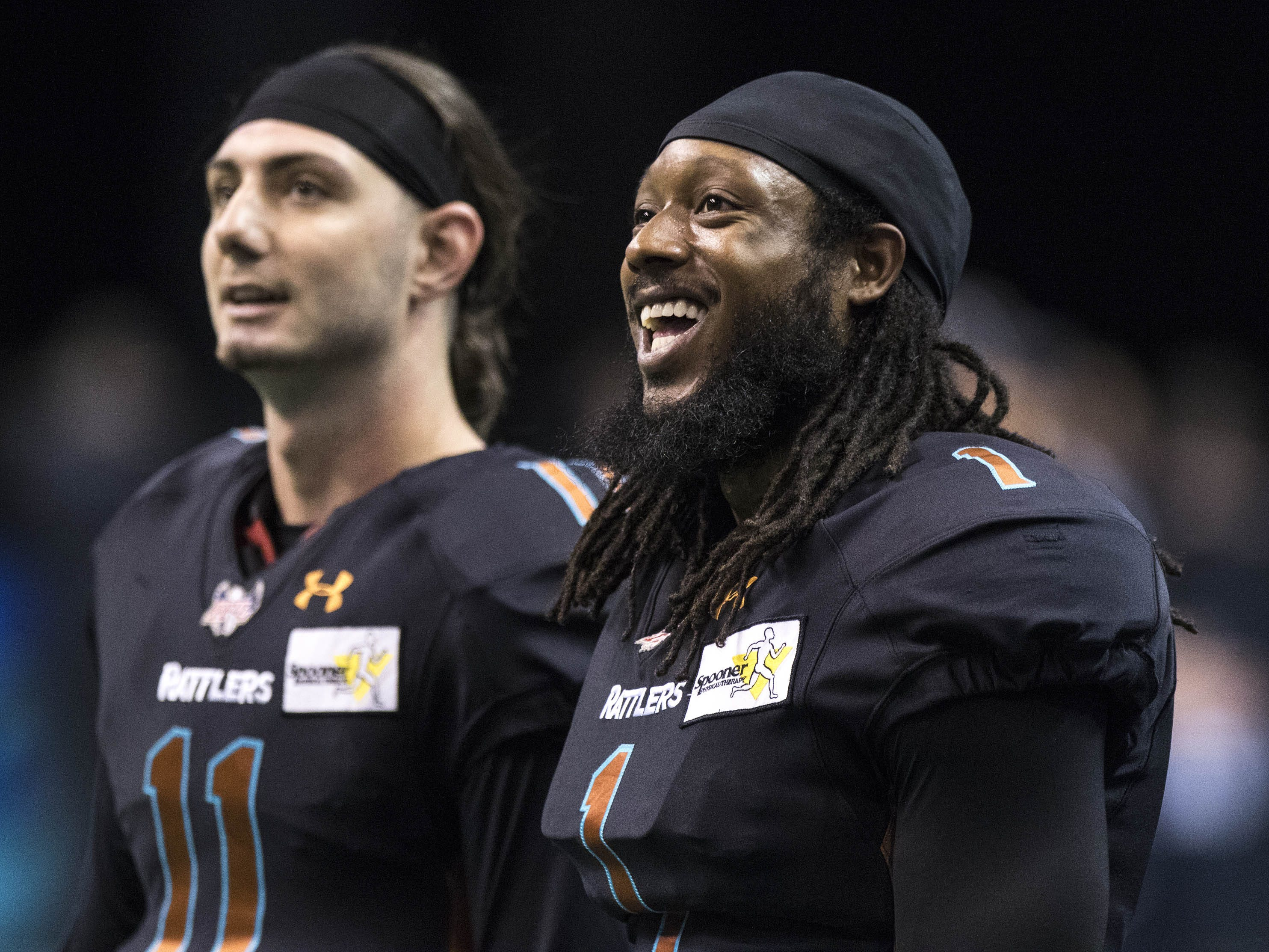 Arizona Rattlers' quarterbacks Jeff Ziemba (11) Verlon Reed Jr. (1) enjoy a laugh before their game against Cedar Rapids River Kings at Talking Stick Resort Arena in Phoenix, Sunday, March 3, 2019.