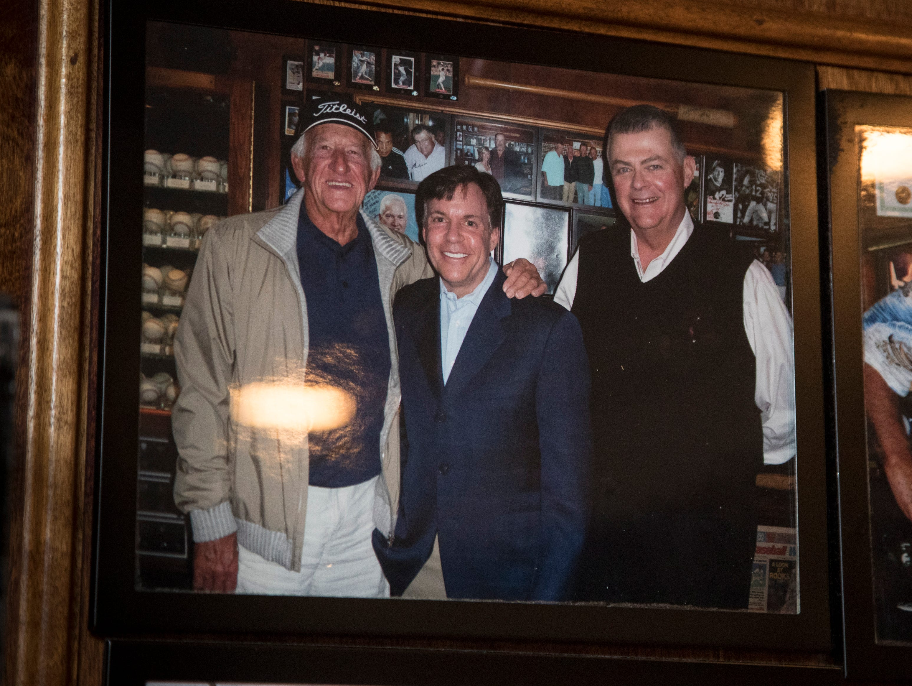 Photo of Don Carson (right) with Bob Costas (center) are seen Feb. 27, 2019, at Don & Charlie's, 7501 E. Camelback Road, Scottsdale.