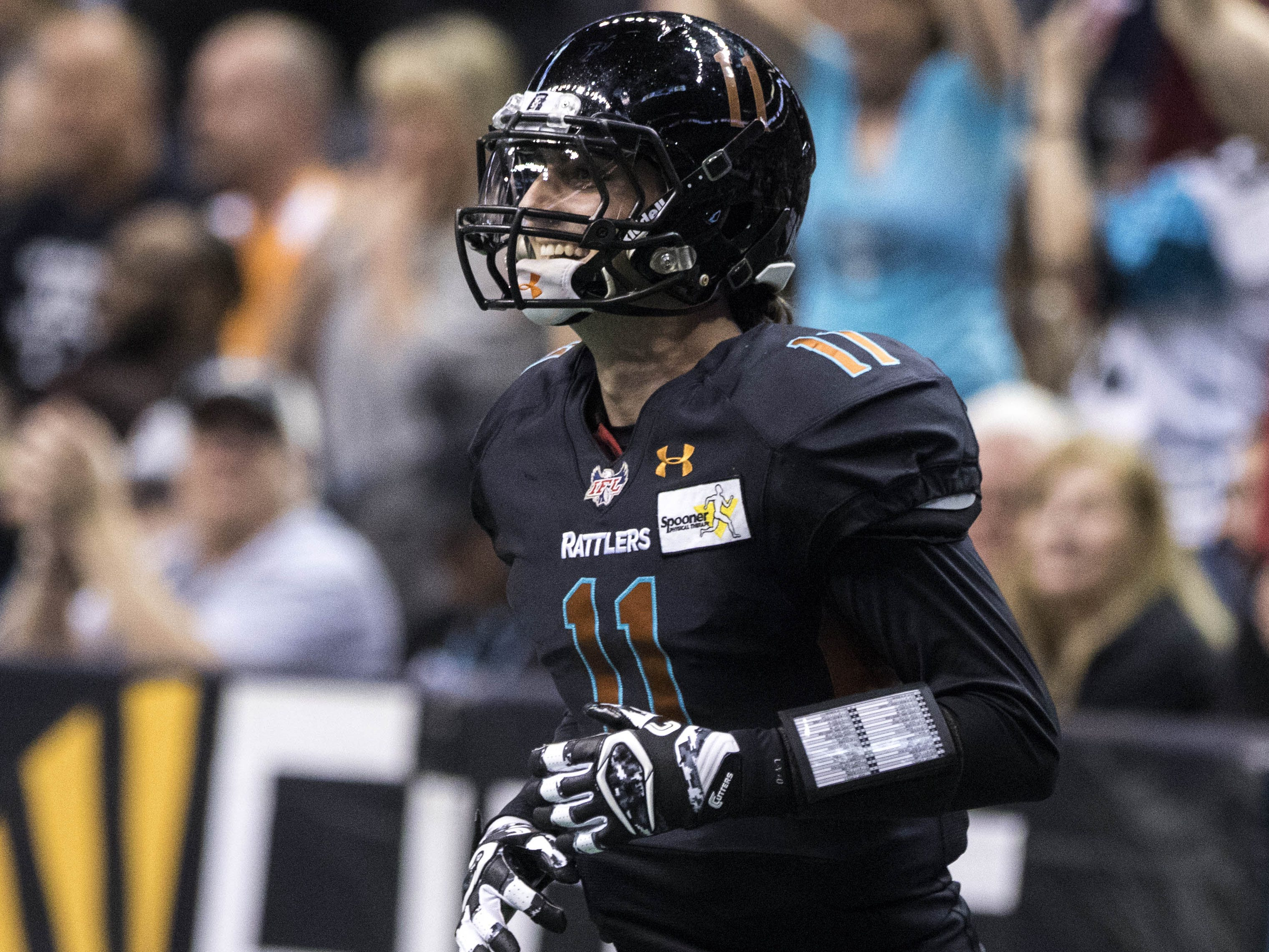 Arizona Rattlers' Jeff Ziemba (11) is all smiles after Jabre Lolley (21) scored a touchdown against the Cedar Rapids River Kings during the second half of their game at Talking Stick Resort Arena in Phoenix, Sunday, March 3, 2019.