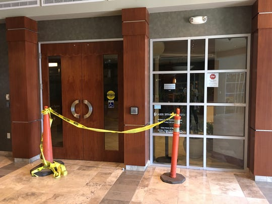 Caution tape outside main entrance of Scottsdale Laser Spine Institute