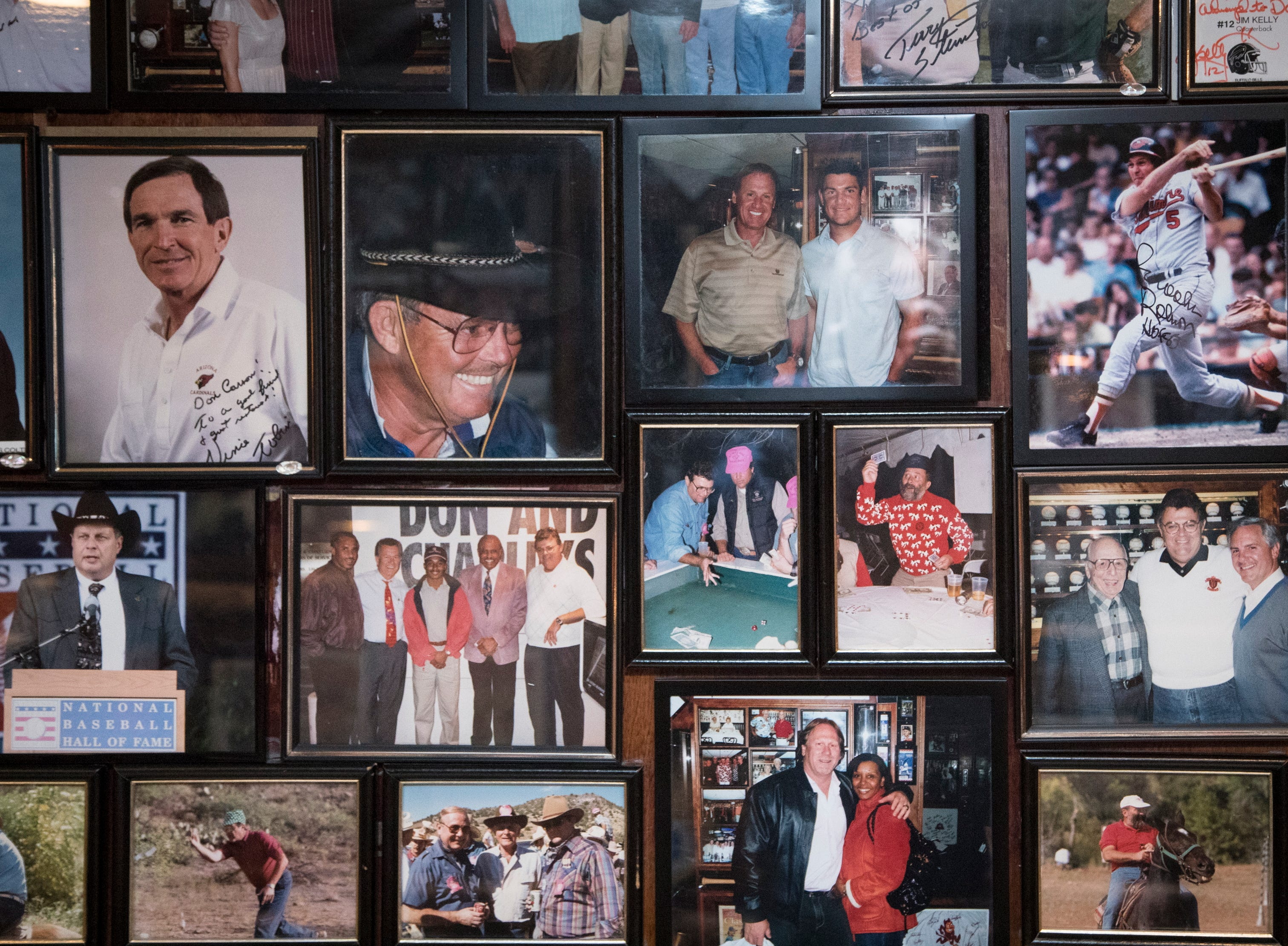 Photos on the wall are seen Feb. 27, 2019, at Don & Charlie's, 7501 E. Camelback Road, Scottsdale.