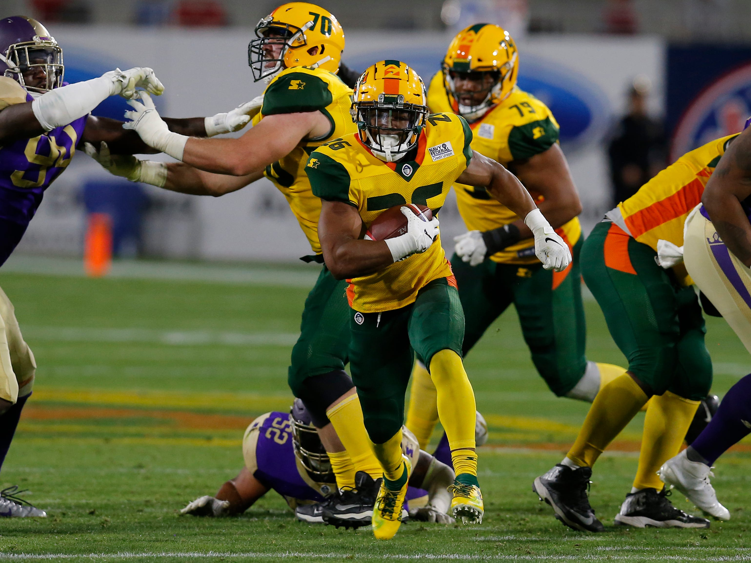 Arizona Hotshots running back Jhurell Pressley (26) runs for a firstdown against the Atlanta Legends in the second half during an AAF football game, Sunday, March 3, 2019, at Sun Devil Stadium in Phoenix.