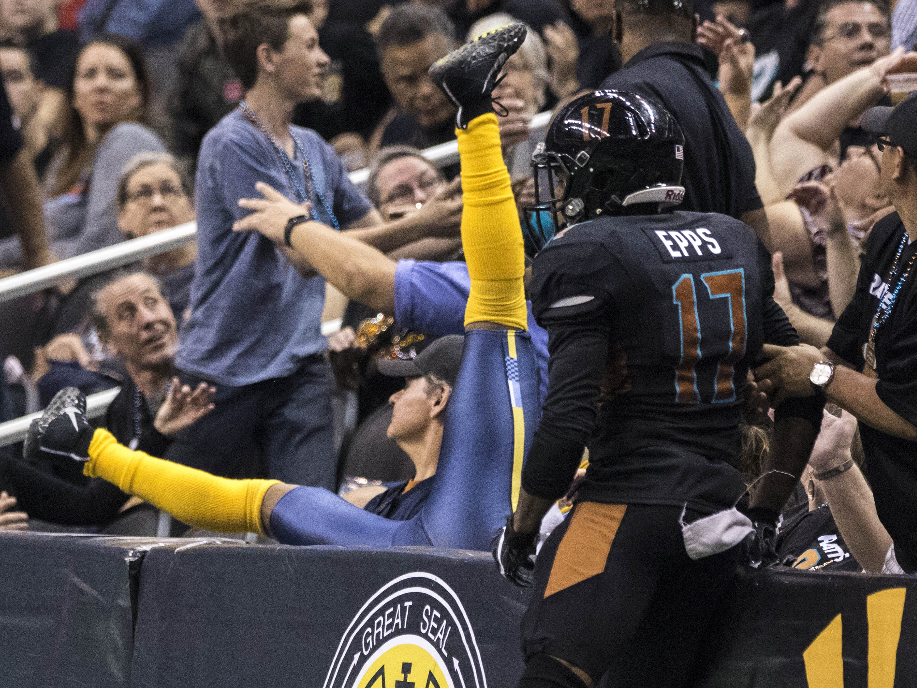 Arizona Rattlers' Dezmon Epps (17) watches as Cedar Rapids River Kings' Jordan Smith (17) goes sprawling into the fans during the second half of their game at Talking Stick Resort Arena in Phoenix, Sunday, March 3, 2019.