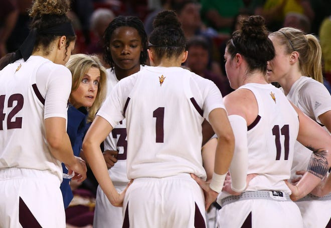 Arizona State head coach Charli Turner Thorne huddles with her players in the second half on Mar. 3, 2019, at Wells Fargo Arena in Tempe, Ariz.