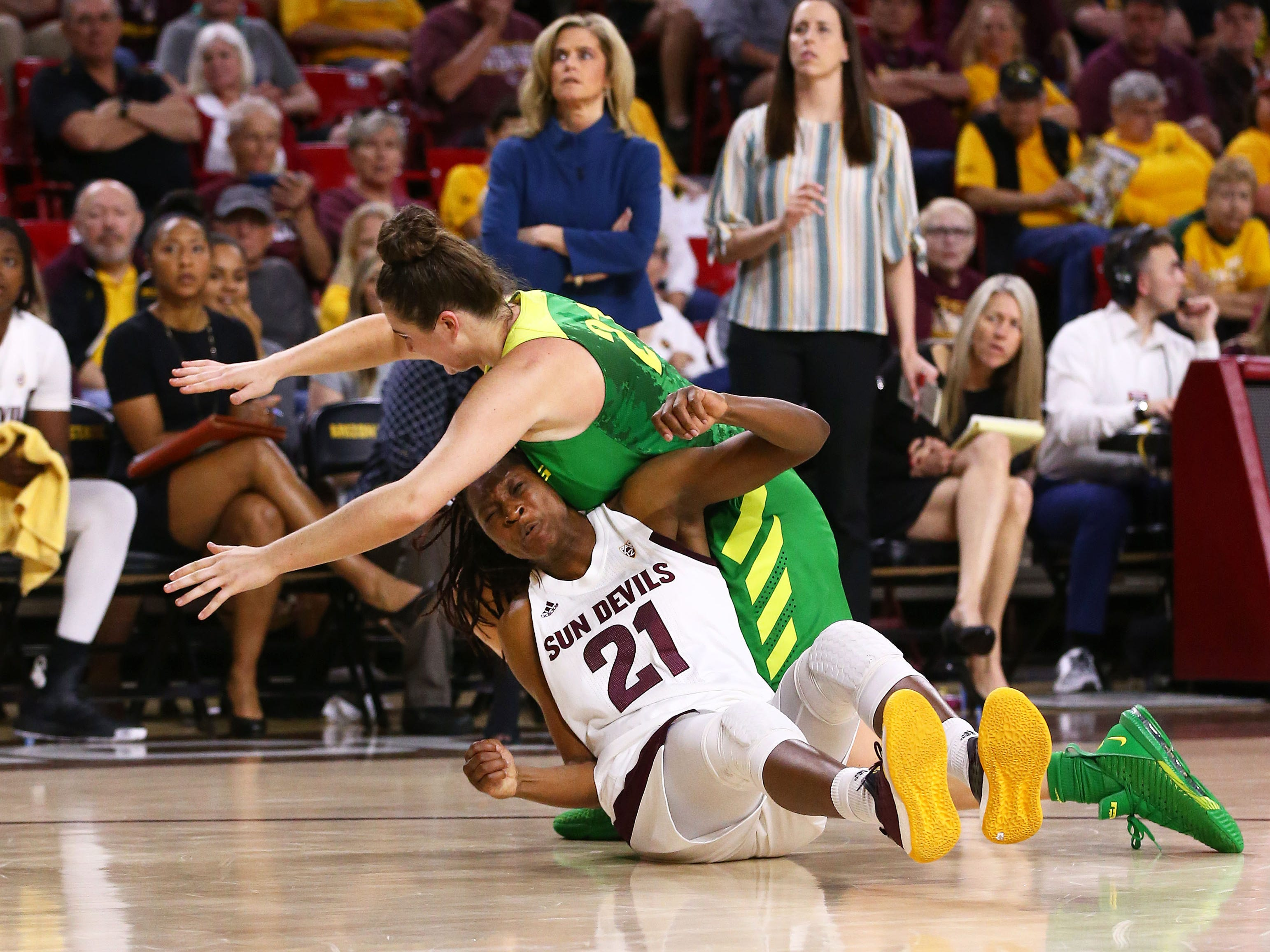 Oregon Ducks forward Erin Boley (21) falls on Arizona State Sun Devils forward Sophia Elenga (21) in the second half on Mar. 3, 2019, at Wells Fargo Arena in Tempe, Ariz.