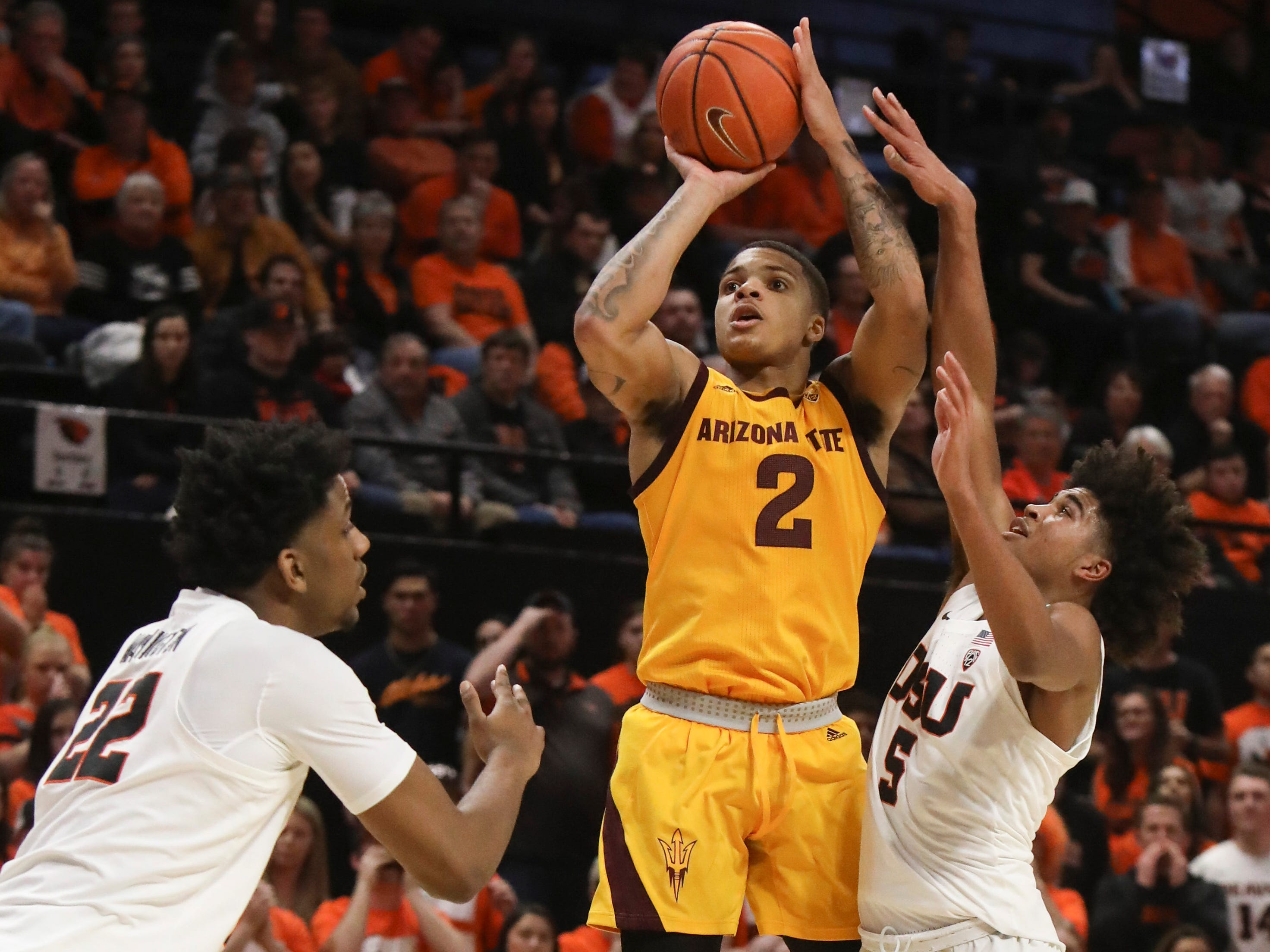Arizona State's Rob Edwards (2) goes up for a shot against Oregon State's Warren Washington (22) and Ethan Thompson (5) during the second half of an NCAA college basketball game in Corvallis, Ore., Sunday, March 3, 2019. Arizona State won 74-71.