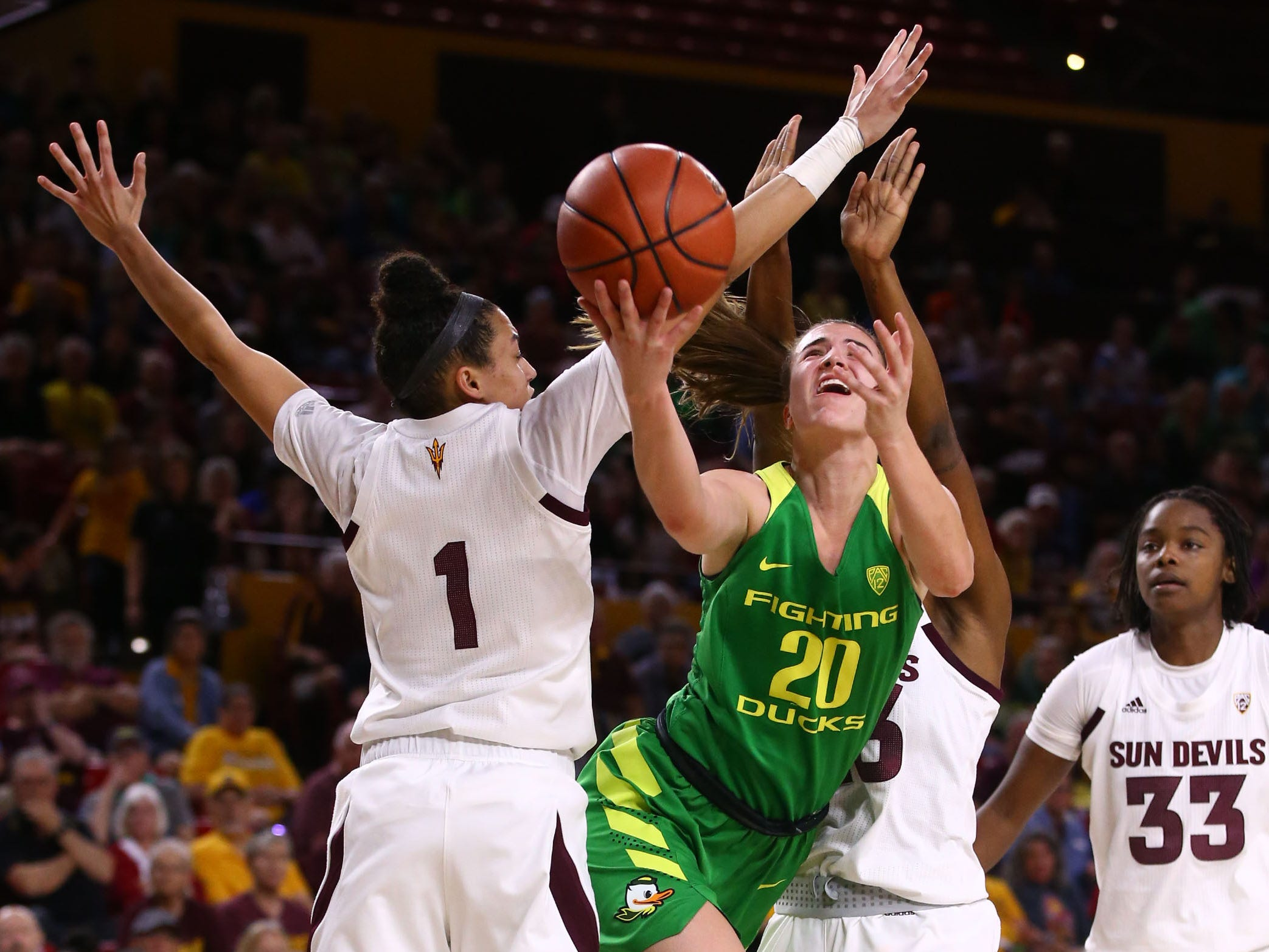 Oregon Ducks guard Sabrina Ionescu (20) shoots and scores past Arizona State Sun Devils guard Reili Richardson (1) in the first half on Mar. 3, 2019, at Wells Fargo Arena in Tempe, Ariz.