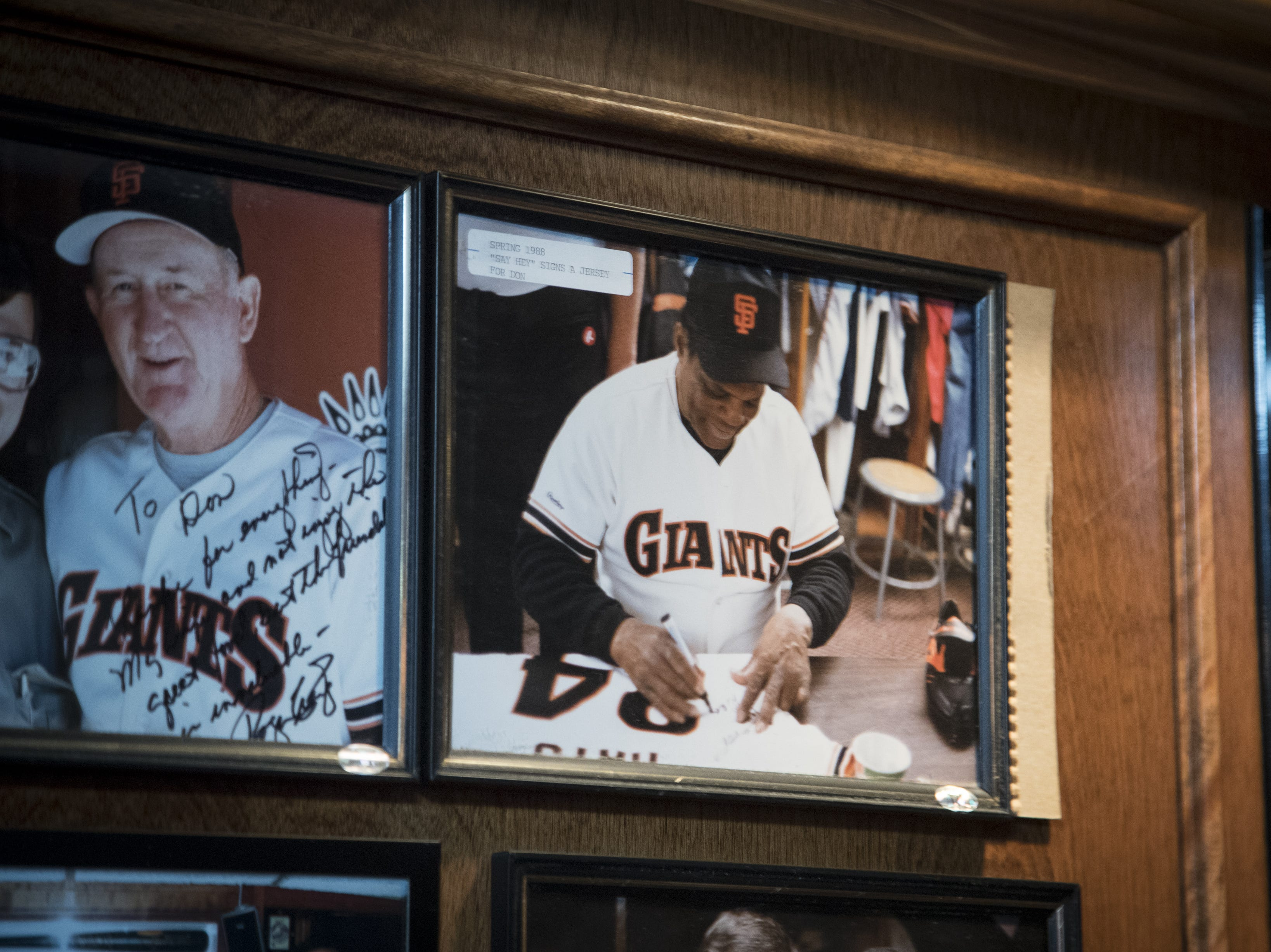 Willie Mays signs the jersey in a photo seen Feb. 27, 2019, that hangs on the ceiling at Don & Charlie's, 7501 E. Camelback Road, Scottsdale.