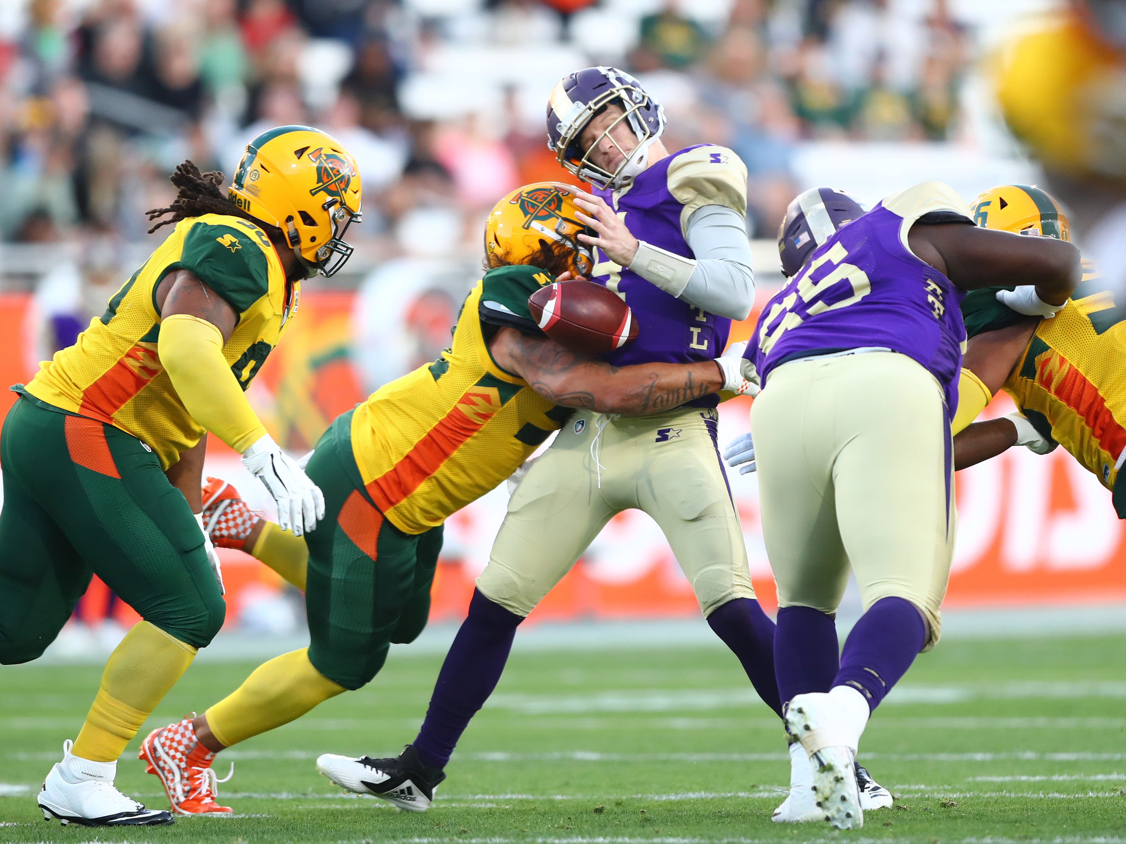 Mar 3, 2019; Tempe, AZ, USA; Atlanta Legends quarterback Matt Simms fumbles the ball as he is sacked by Arizona Hotshots linebacker Carl Bradford during the first quarter of an AAF football game at Sun Devil Stadium.