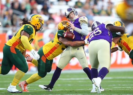 Mar 3, 2019; Tempe, AZ, USA; Atlanta Legends quarterback Matt Simms fumbles the ball as he is sacked by Arizona Hotshots linebacker Carl Bradford during the first quarter of an AAF football game at Sun Devil Stadium.