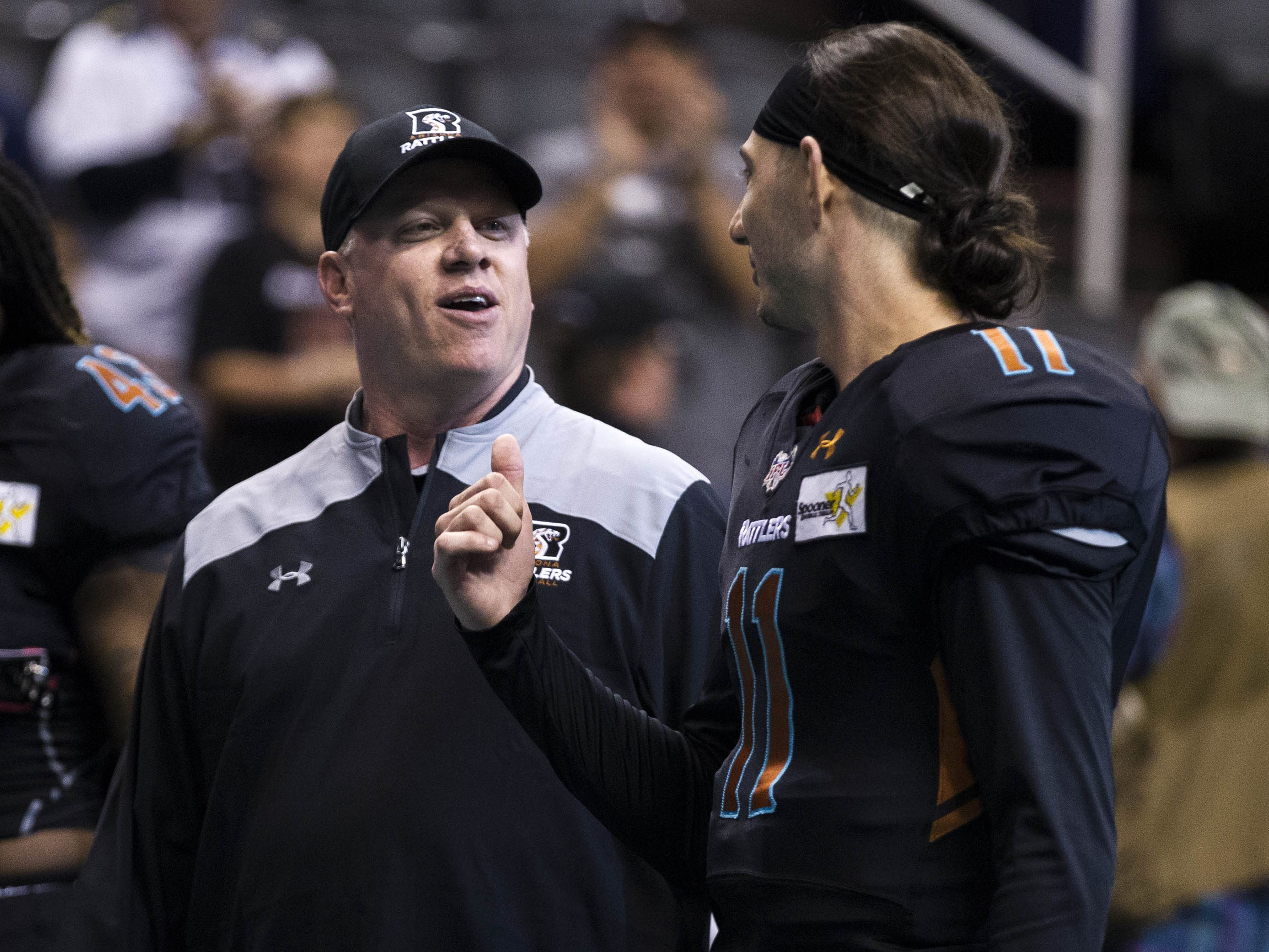 Arizona Rattlers' head coach Kevin Guy talks to his quarterback Jeff Ziemba (11) before their game against the Cedar Rapids River Kings at Talking Stick Resort Arena in Phoenix, Sunday, March 3, 2019.