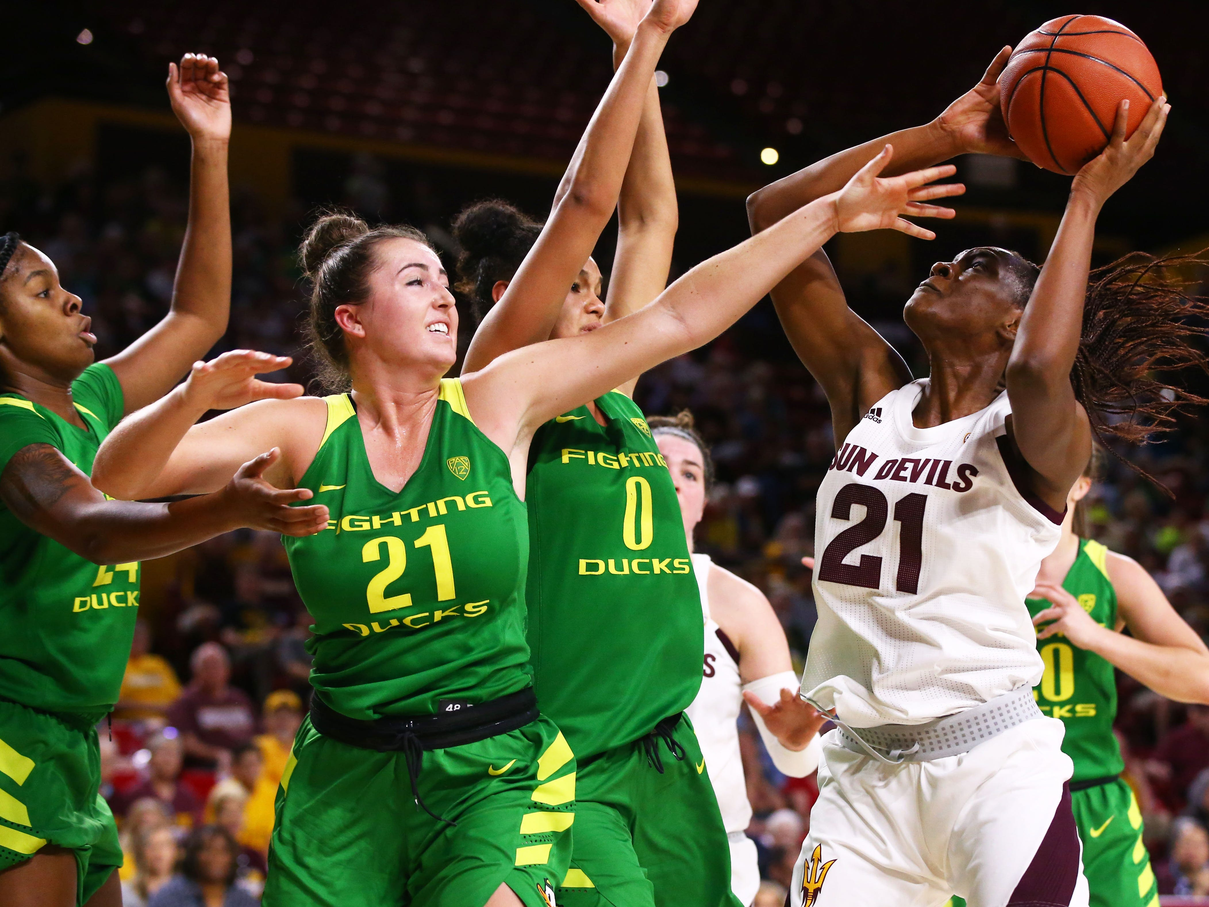 Arizona State Sun Devils forward Sophia Elenga (21) is pressured by Oregon Ducks forward Erin Boley (21) in the second half on Mar. 3, 2019, at Wells Fargo Arena in Tempe, Ariz.