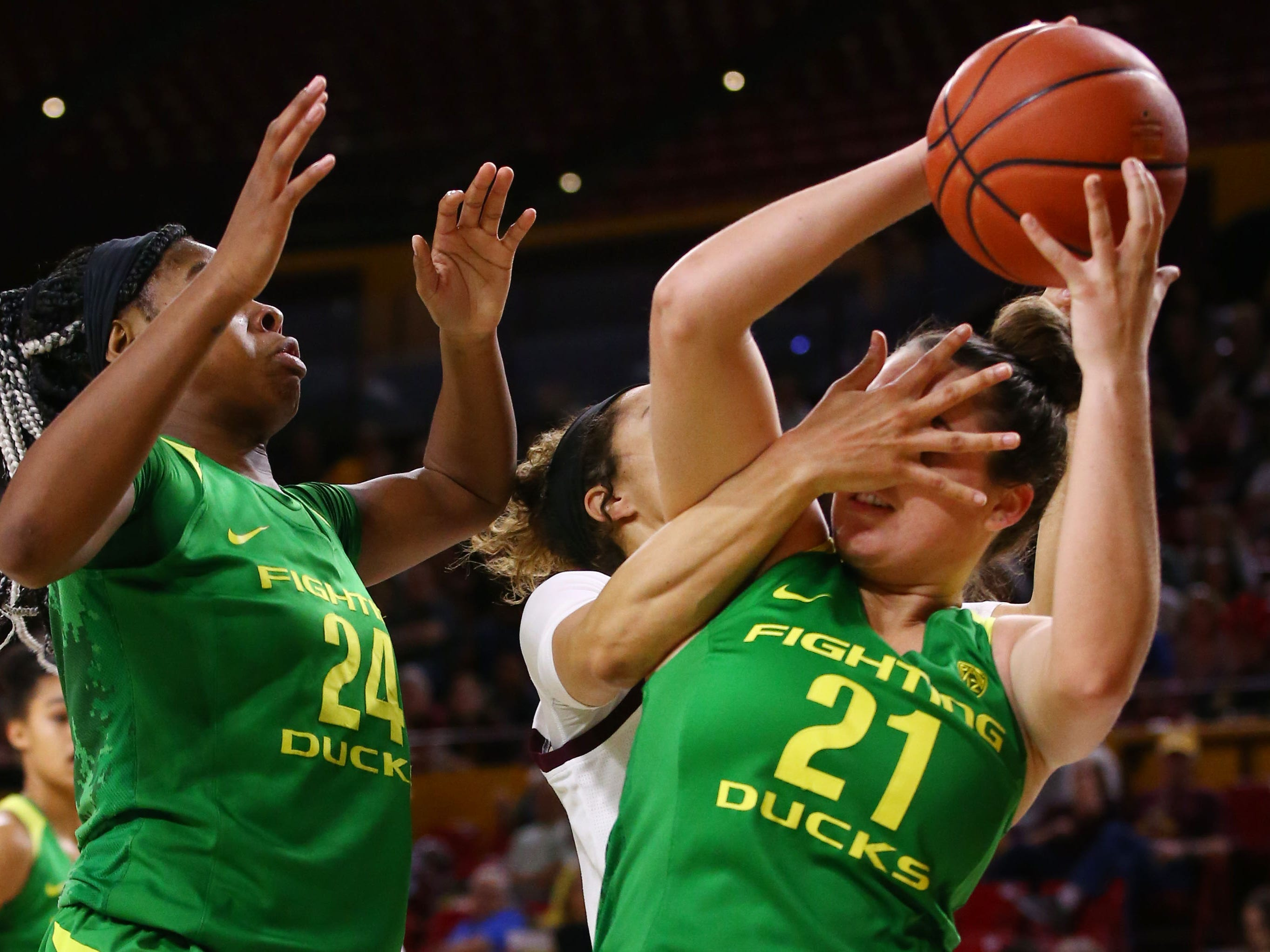 Oregon Ducks forward Erin Boley (21) gets a hand in the face by Arizona State Sun Devils forward Kianna Ibis (42) in the first half on Mar. 3, 2019, at Wells Fargo Arena in Tempe, Ariz.