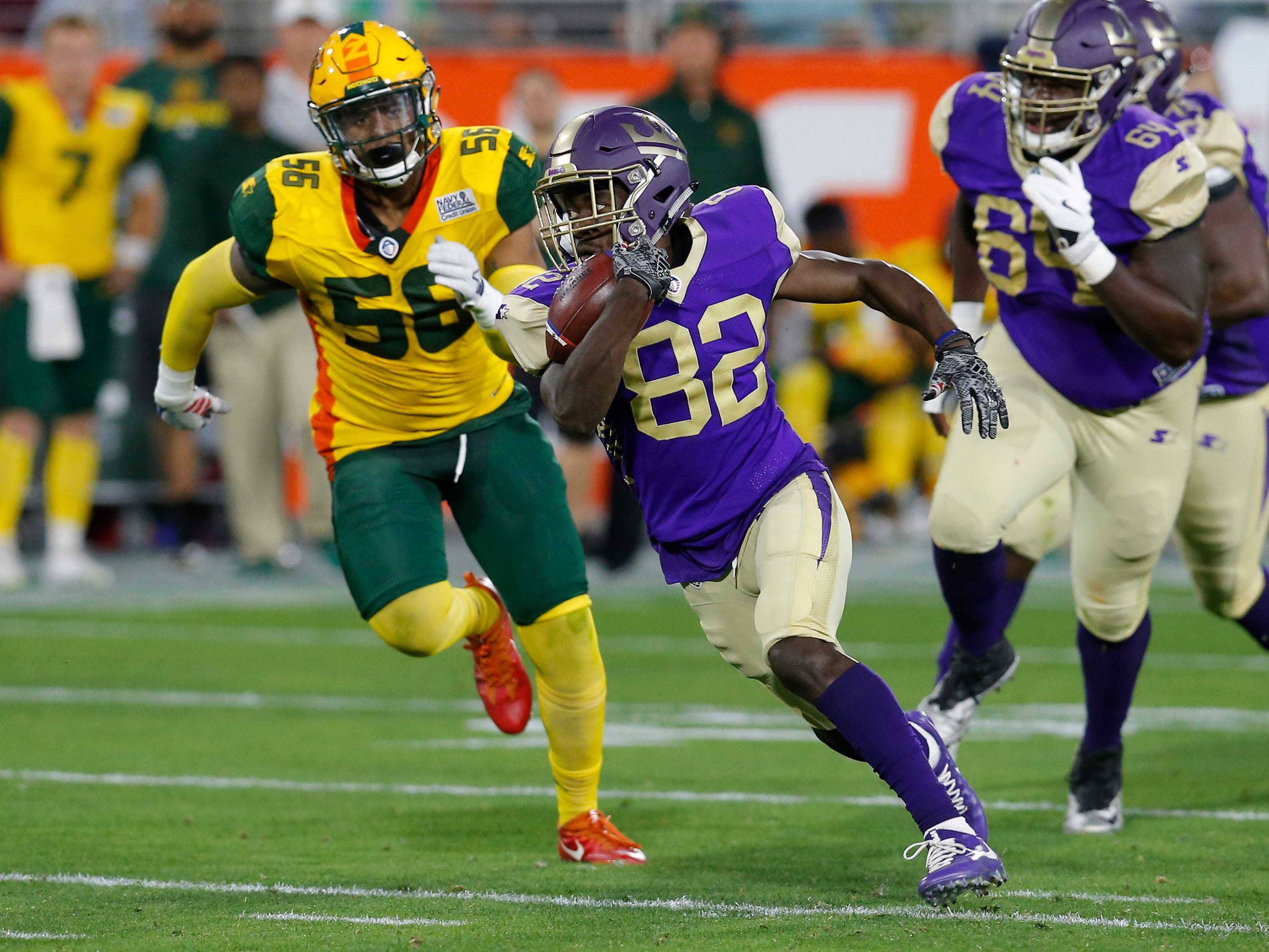 Atlanta Legends wide receiver Ervin Philips (82) runs away from Arizona Hotshots linebacker Da'Sean Downey (56) in the first half during an AAF football game, Sunday, March 3, 2019, at Sun Devil Stadium in Phoenix.