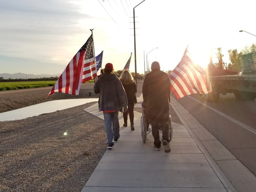 Protesters arrive at Perry High School shortly after 7 a.m. March 5, 2019, to protest after students said they were told to remove MAGA gear while on campus March 1.