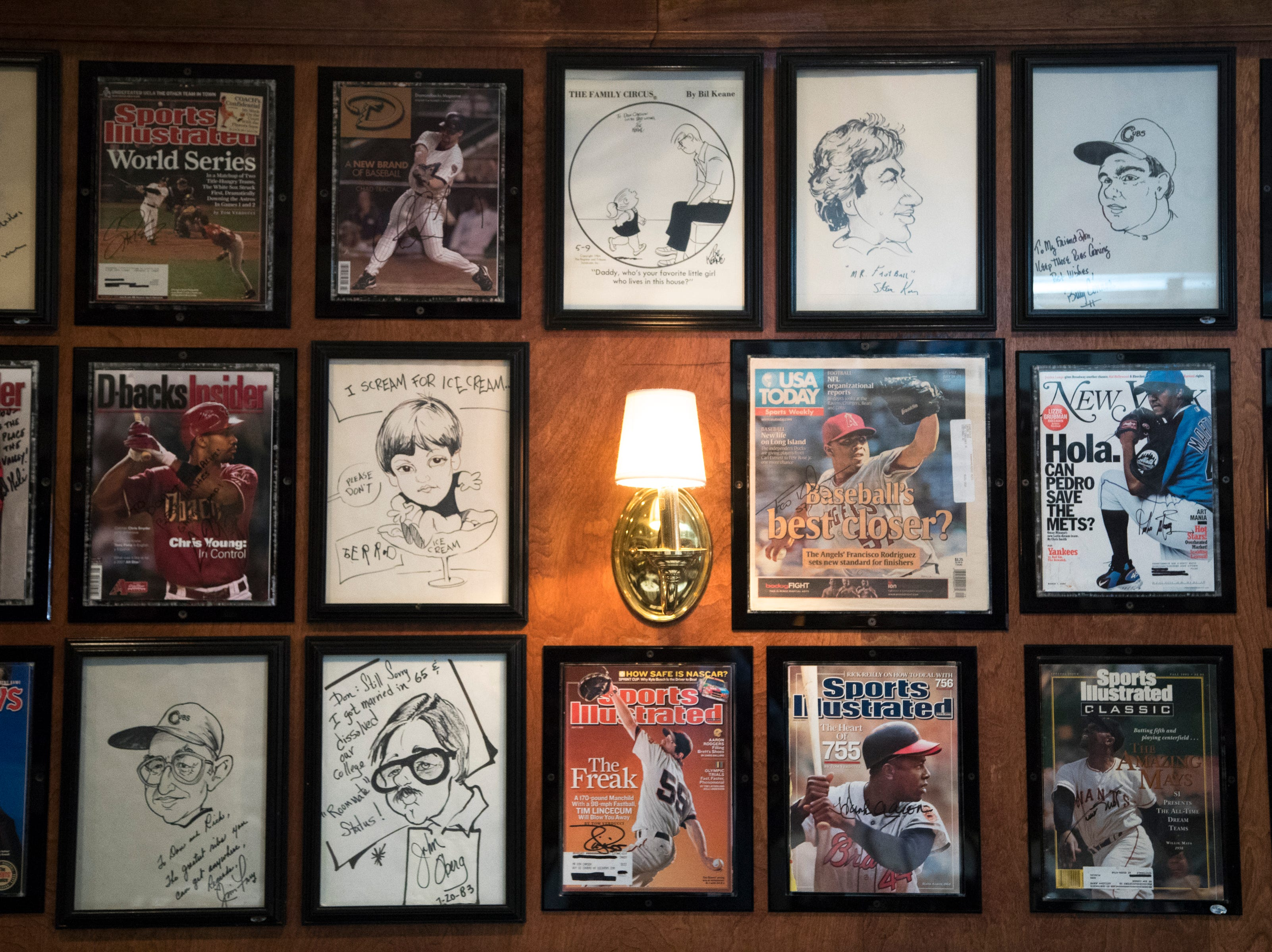 Magazine covers and caricatures are seen Feb. 27, 2019, at Don & Charlie's, 7501 E. Camelback Road, Scottsdale.