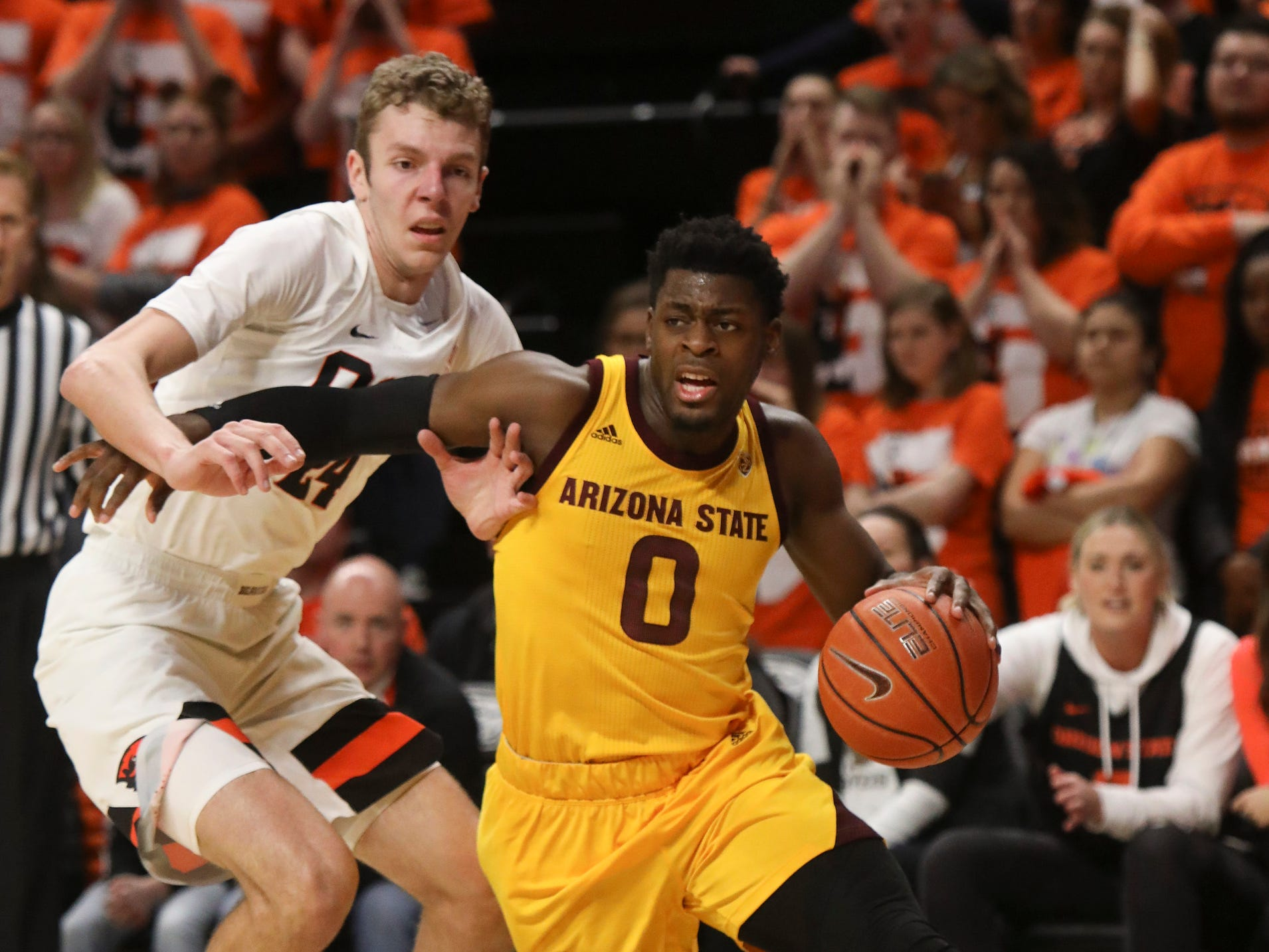Arizona State's Luguentz Dort (0) drives to the basket, past Oregon State's Kylor Kelley (24) during the first half of an NCAA college basketball game in Corvallis, Ore., Sunday, March 3, 2019.