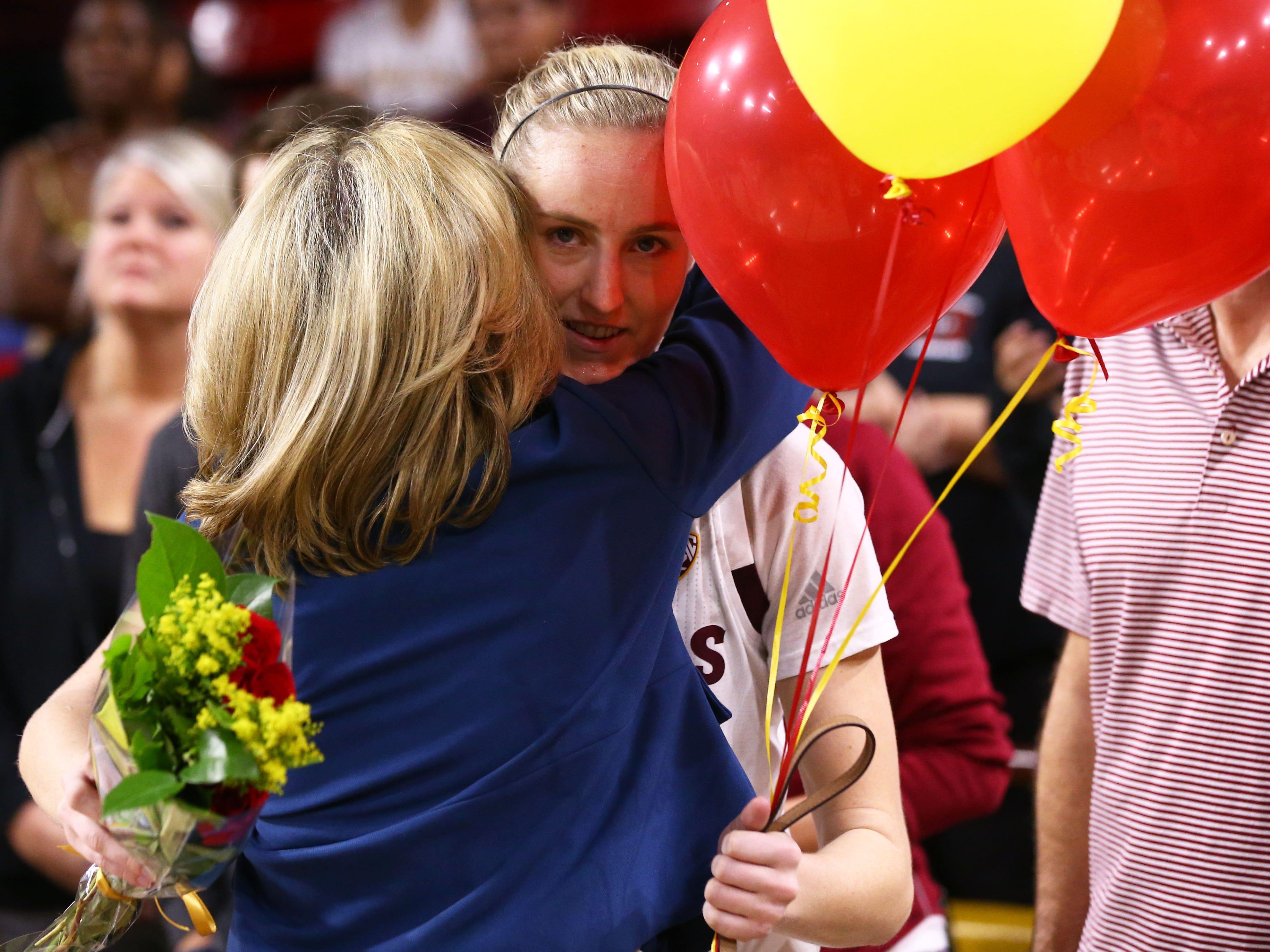 Arizona State Sun Devils guard Courtney Ekmark (22) is hugged by head coach Charli Turner Thorne during senior day ceremonies on Mar. 3, 2019, at Wells Fargo Arena in Tempe, Ariz.