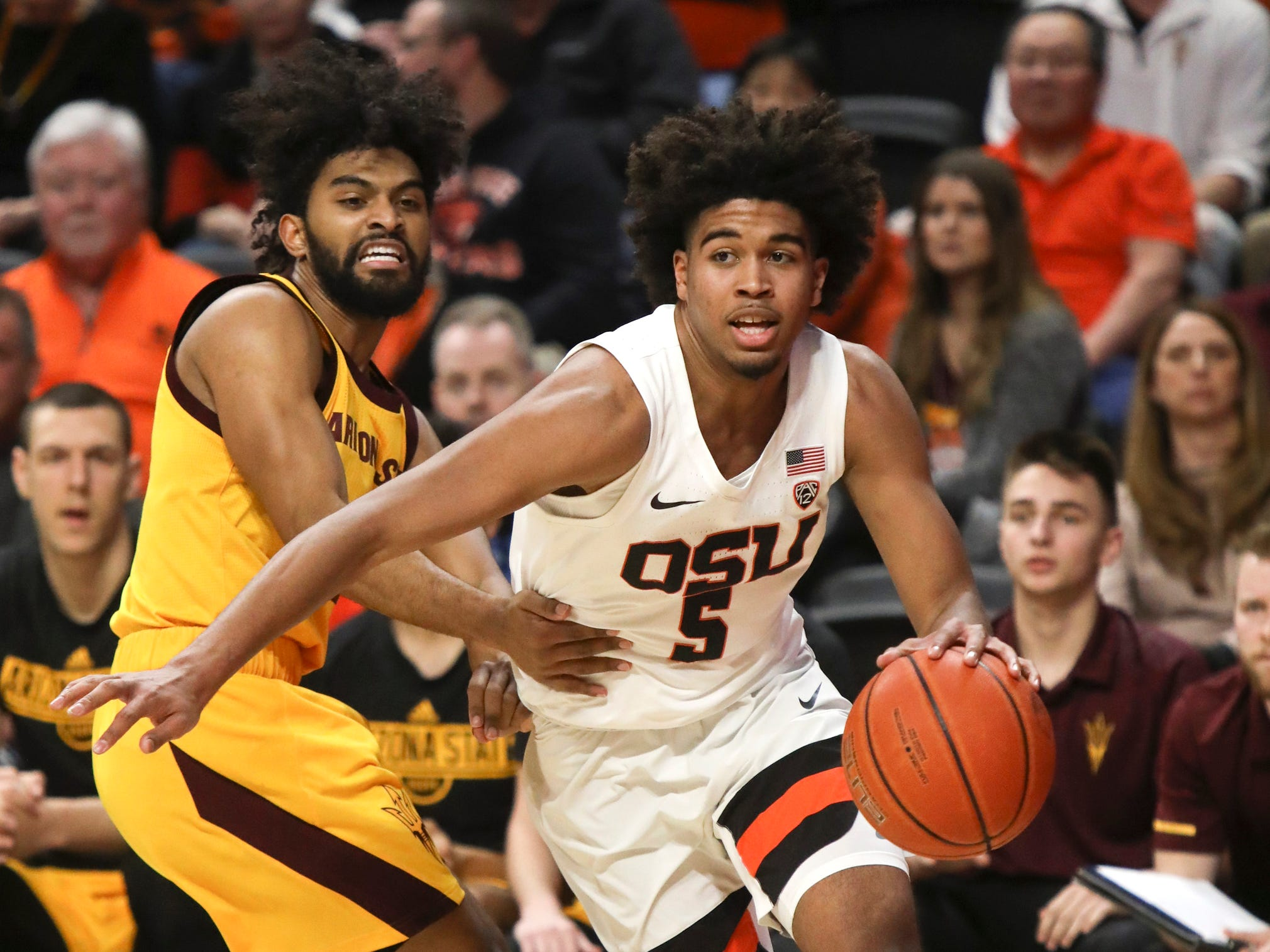 Oregon State's Ethan Thompson (5) slips past Arizona State's Remy Martin (1) during the first half of an NCAA college basketball game in Corvallis, Ore., Sunday, March 3, 2019.