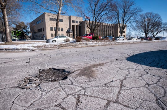 Potholes spot McMorran Boulevard near the intersection of Michigan Street in Port Huron.